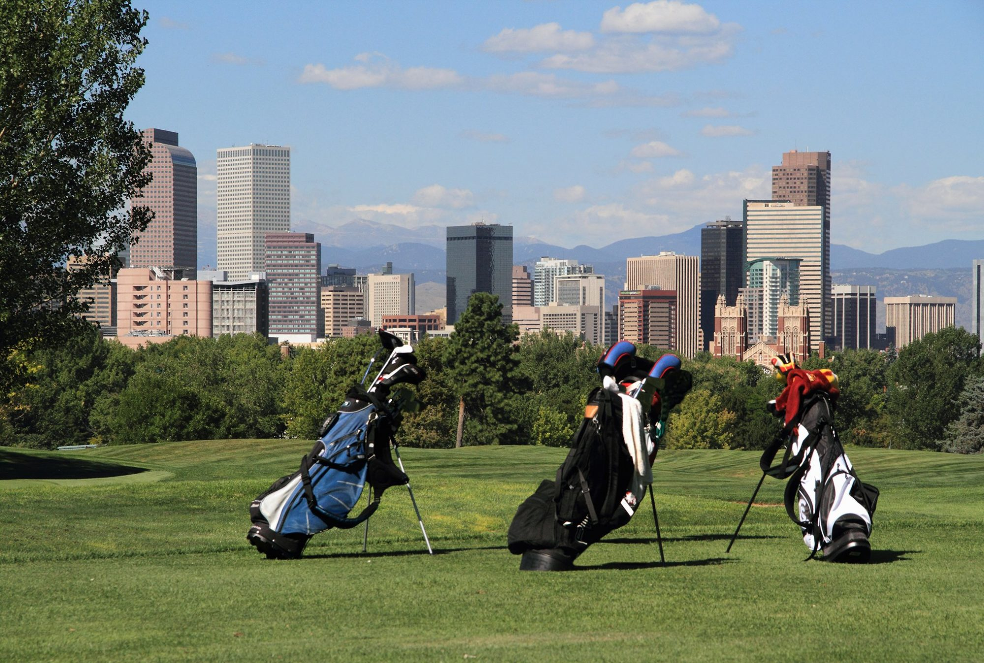 City Park Golf Course with downtown skyline and Rocky Mountains behind, Denver, Colorado.
