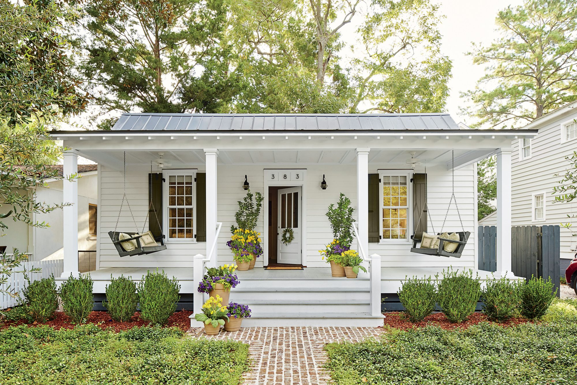 see how one designer moved back home to build her dream cottage white cottage porch with swings