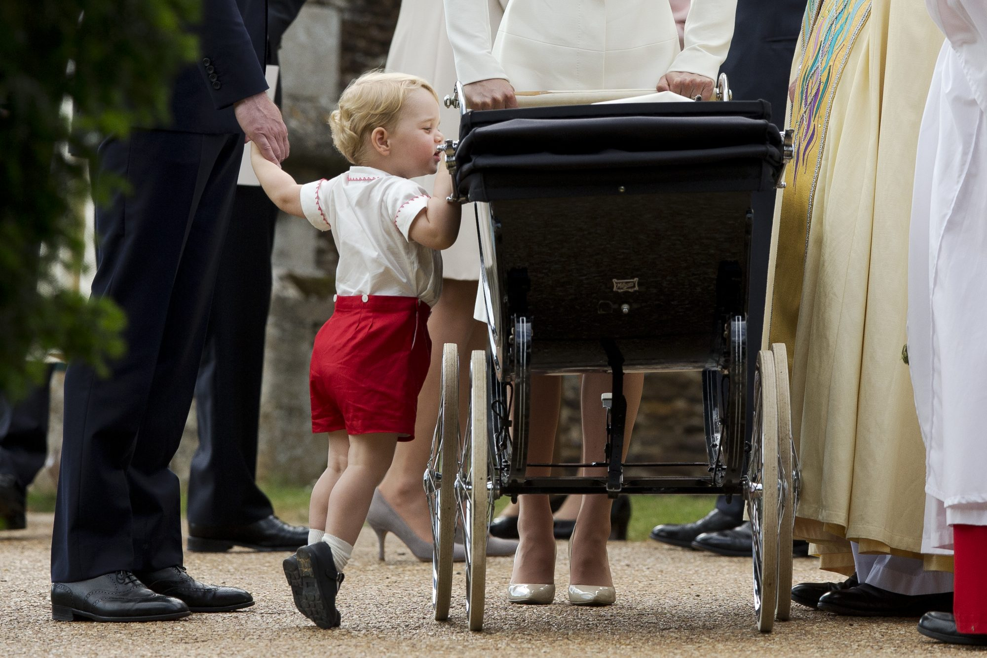 Our Prince Charming! 15 Adorable Photos of George Checking On Charlotte At Her Christening