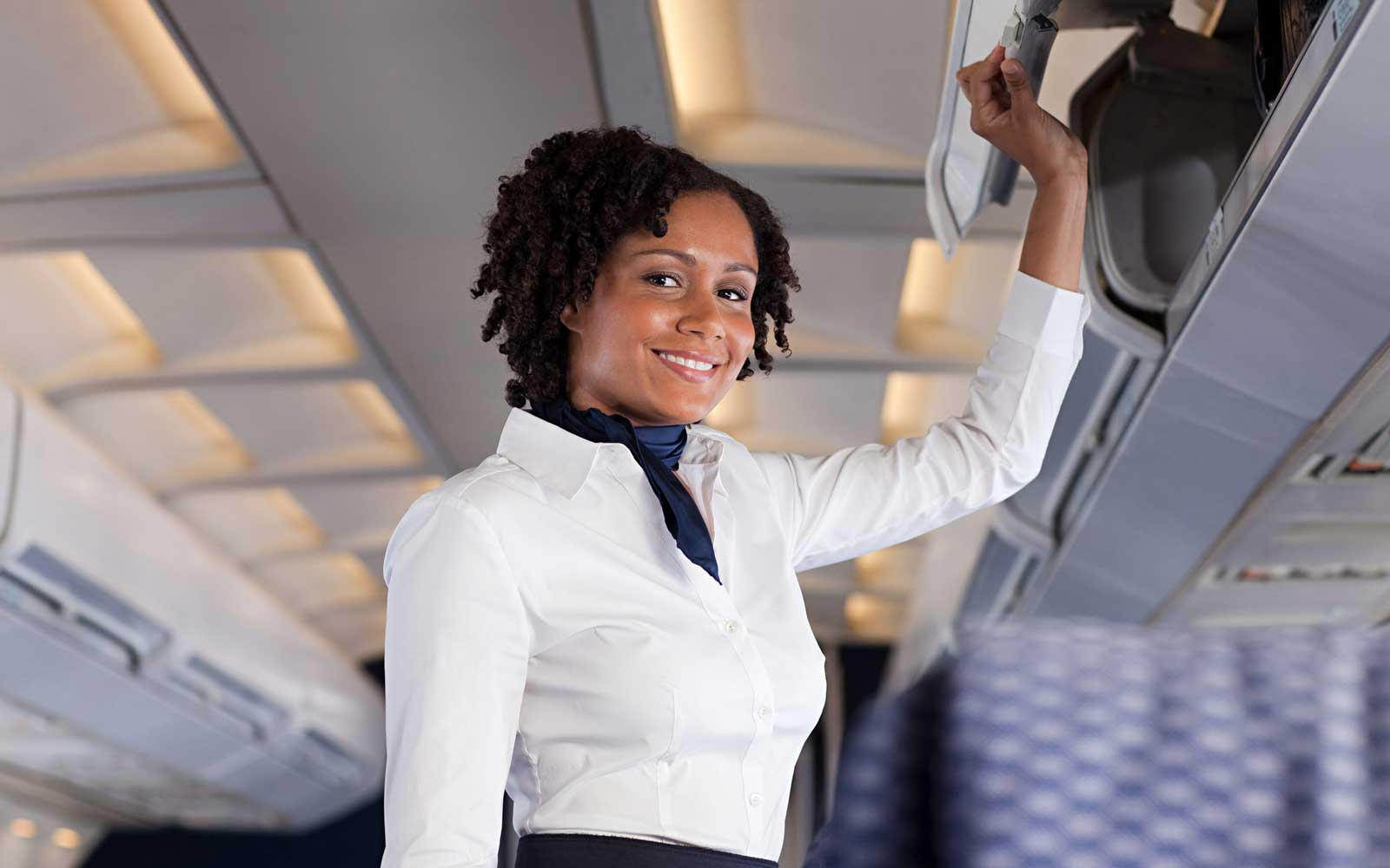 Flight Attendant on an airplane