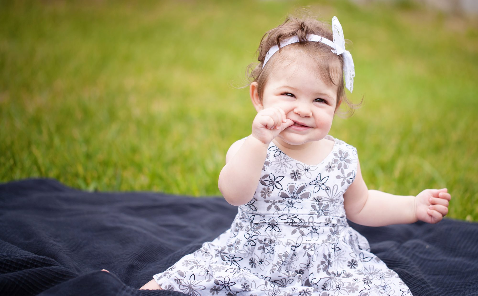 Baby Girl in Grass Wearing Dress