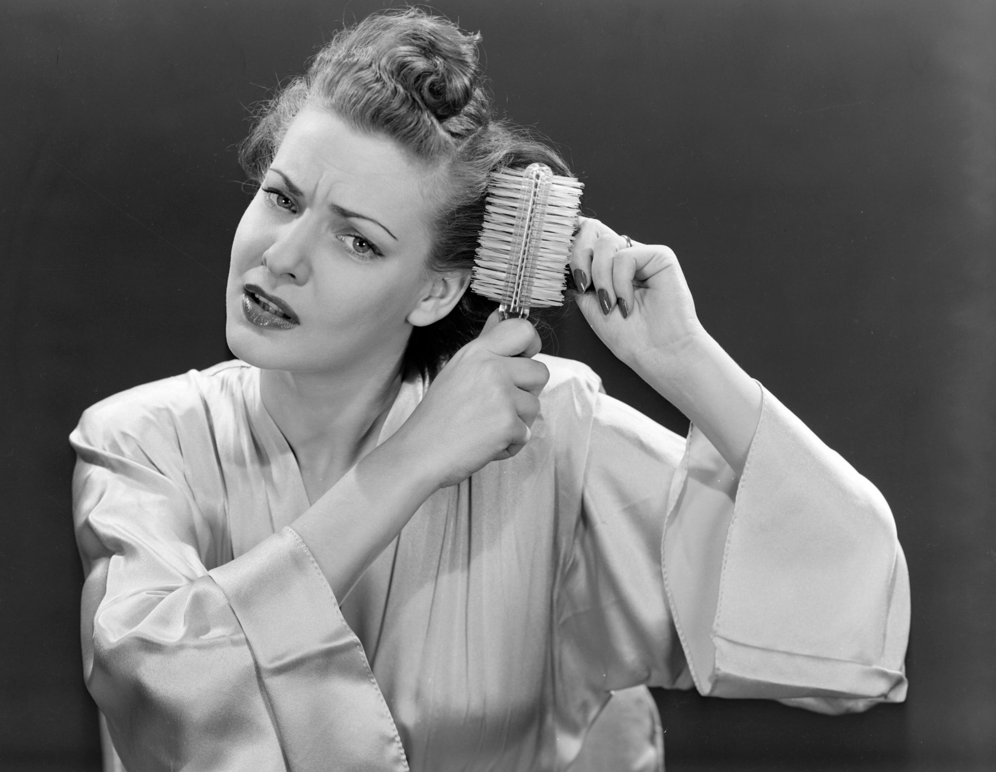 Vintage Woman Brushing Curly Hair