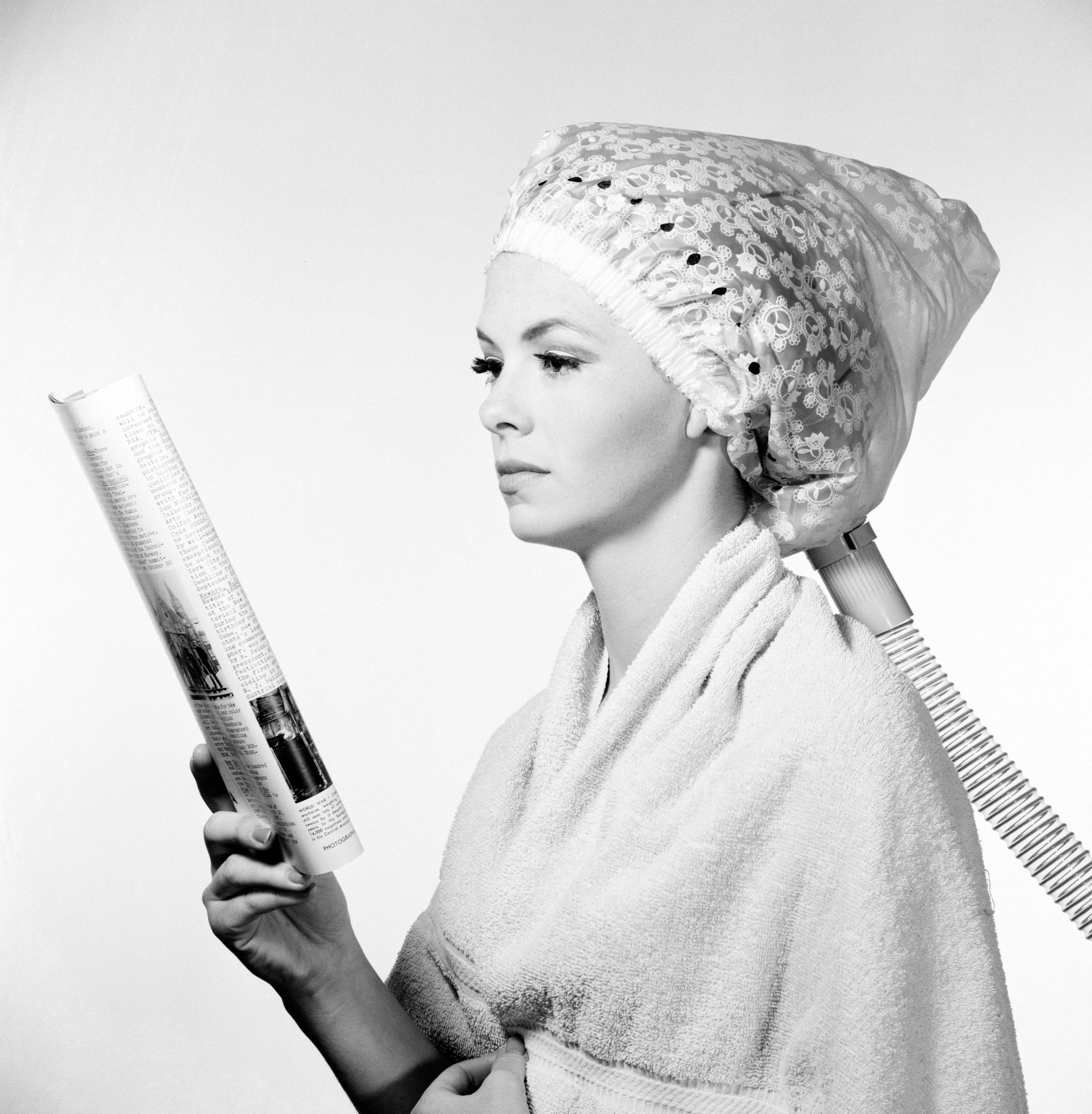 Vintage Woman Sitting Under Hair Dryer