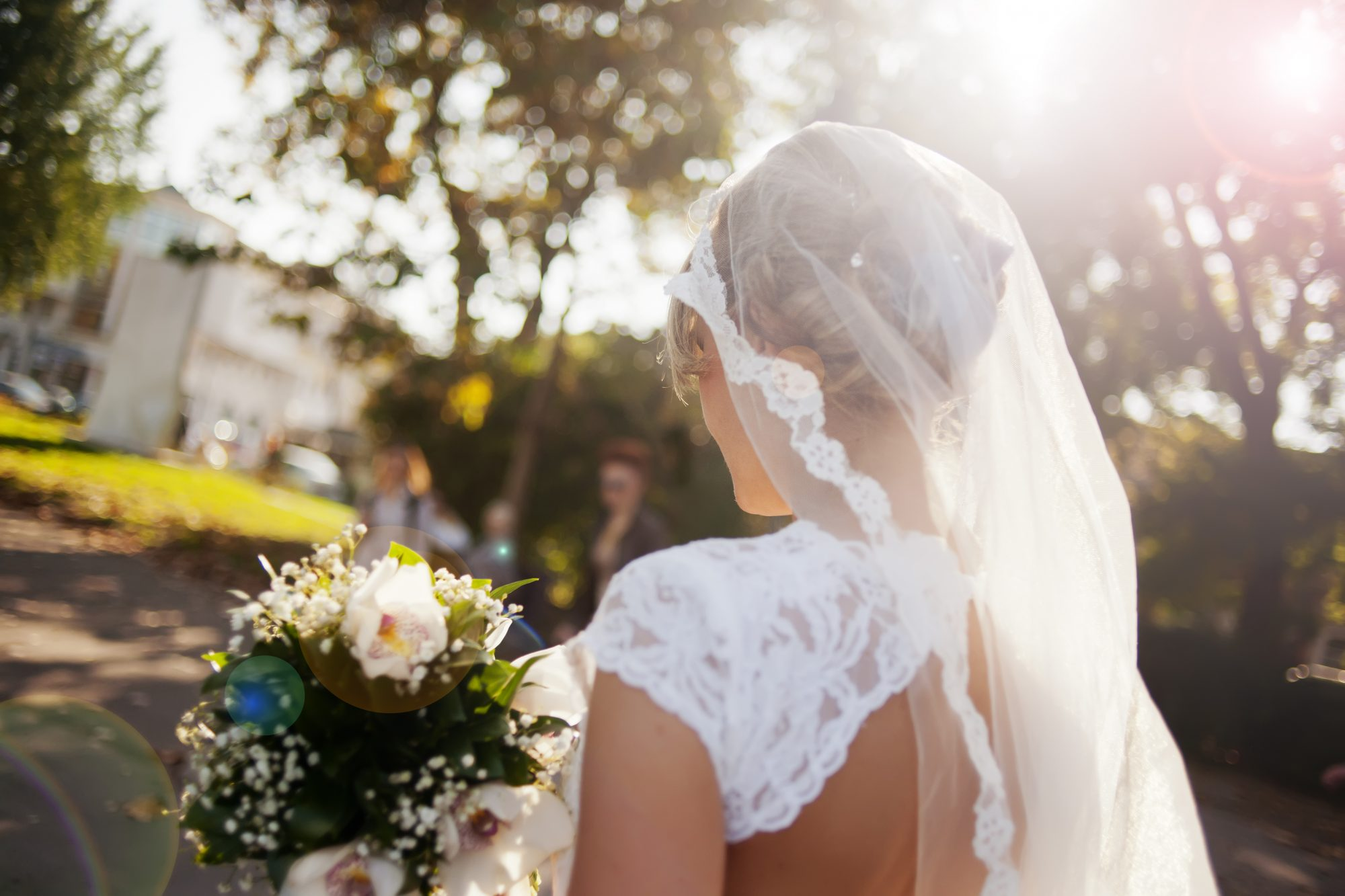 Bride with Veil and Open Back Dress