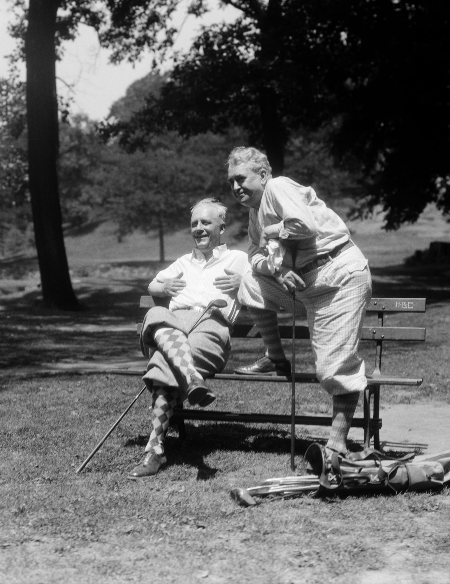 Old Men Smiling While Golfing