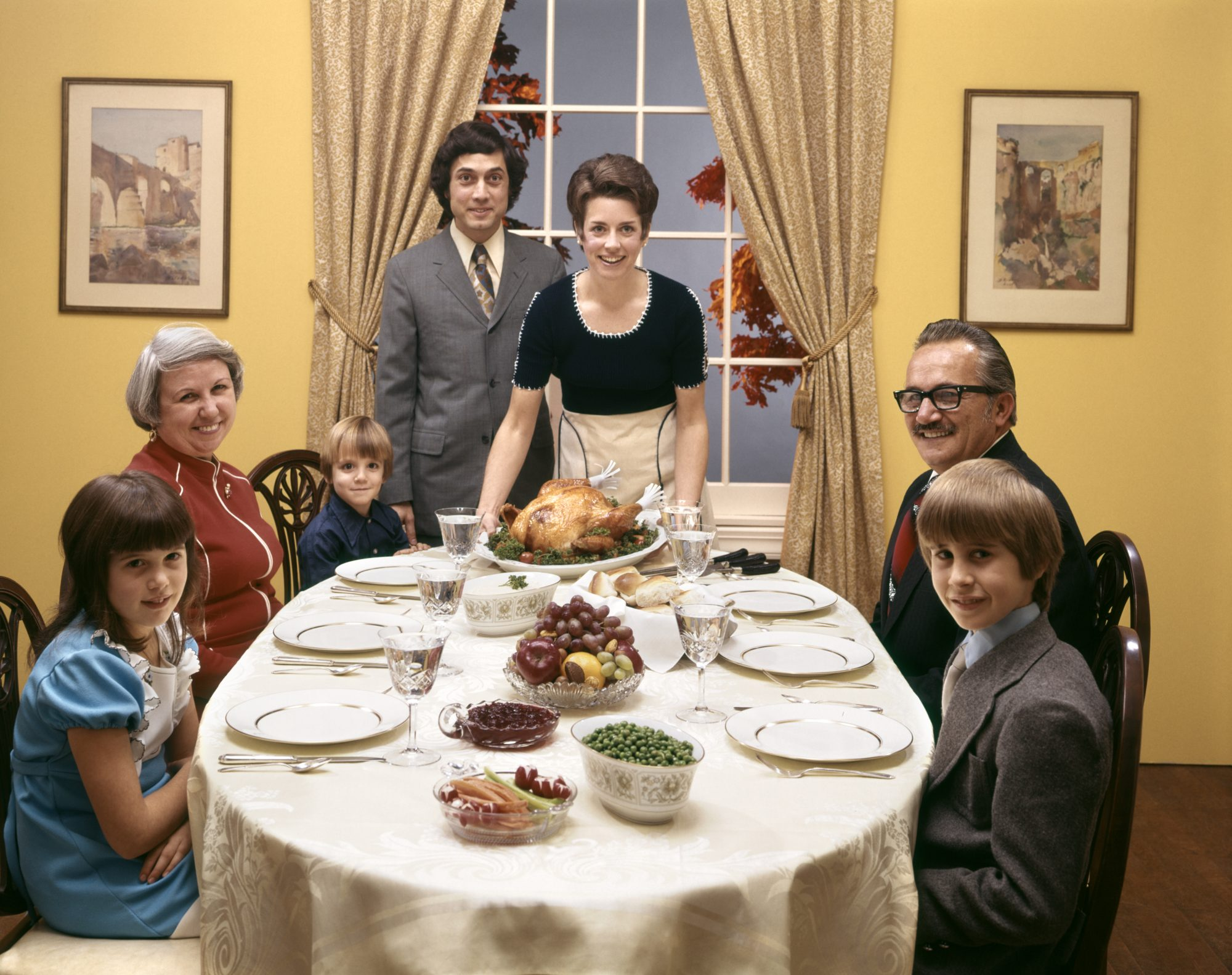 Family Sitting Around Thanksgiving Table