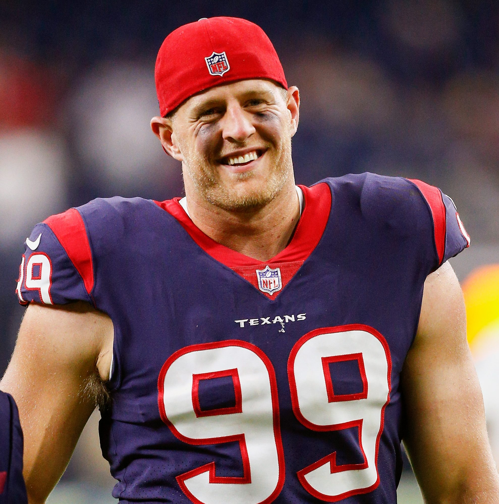 JJ Watt smiling in uniform