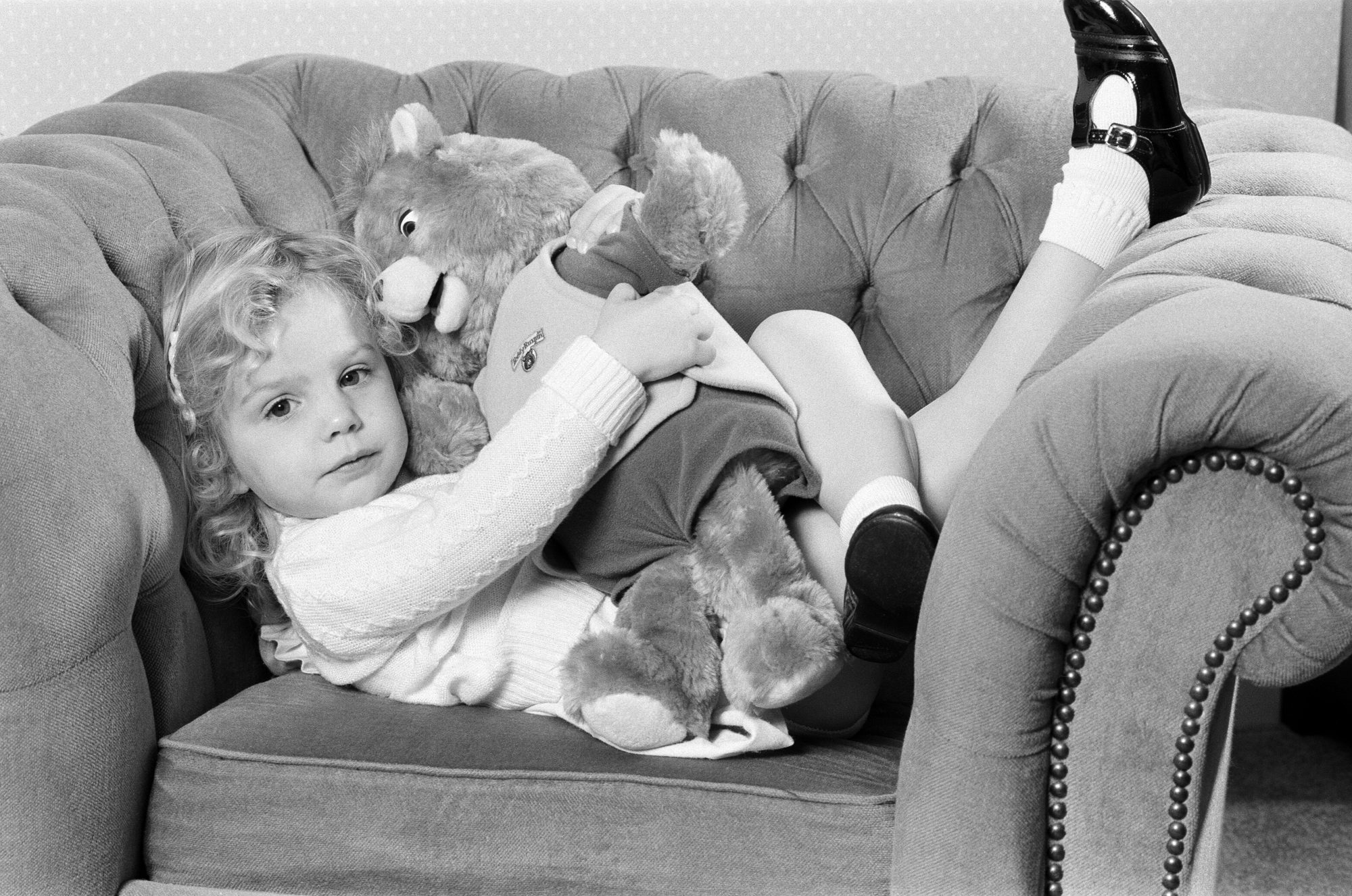 Girl Holding Teddy Ruxpin Bear