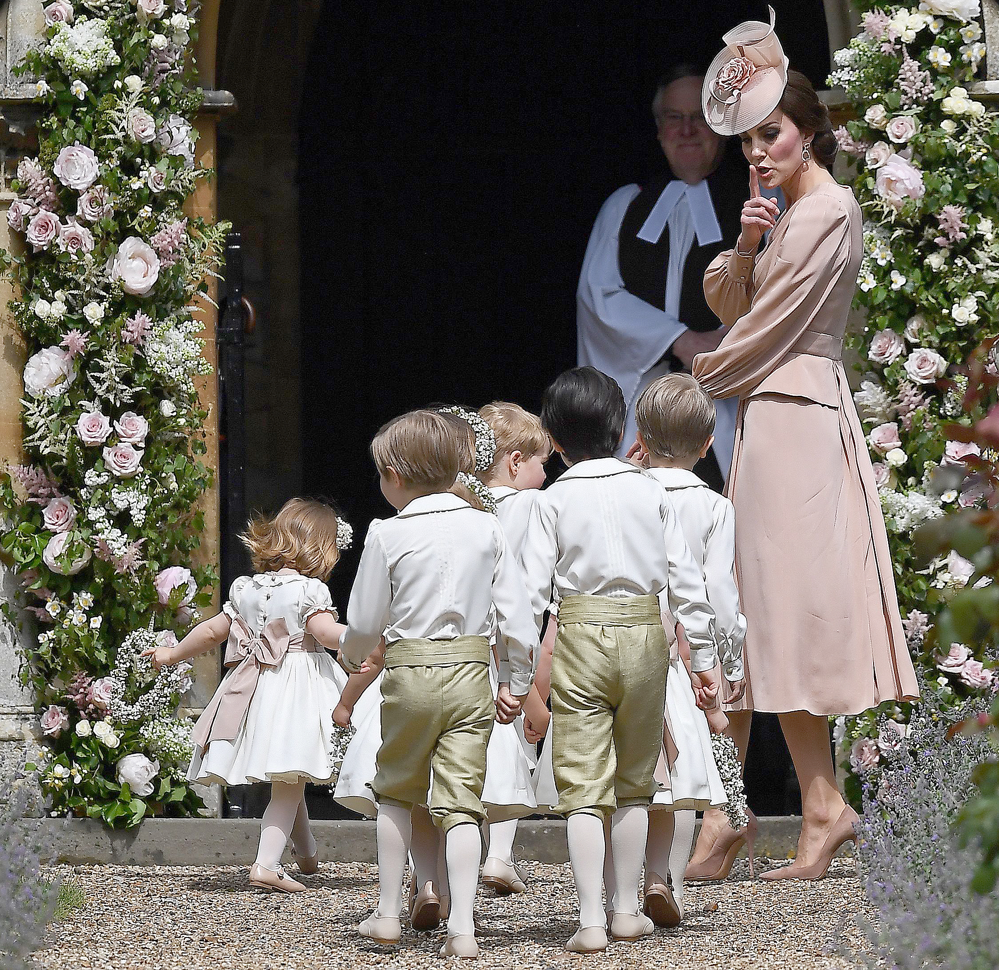 Princess Kate shushes the children as they arrive at the church