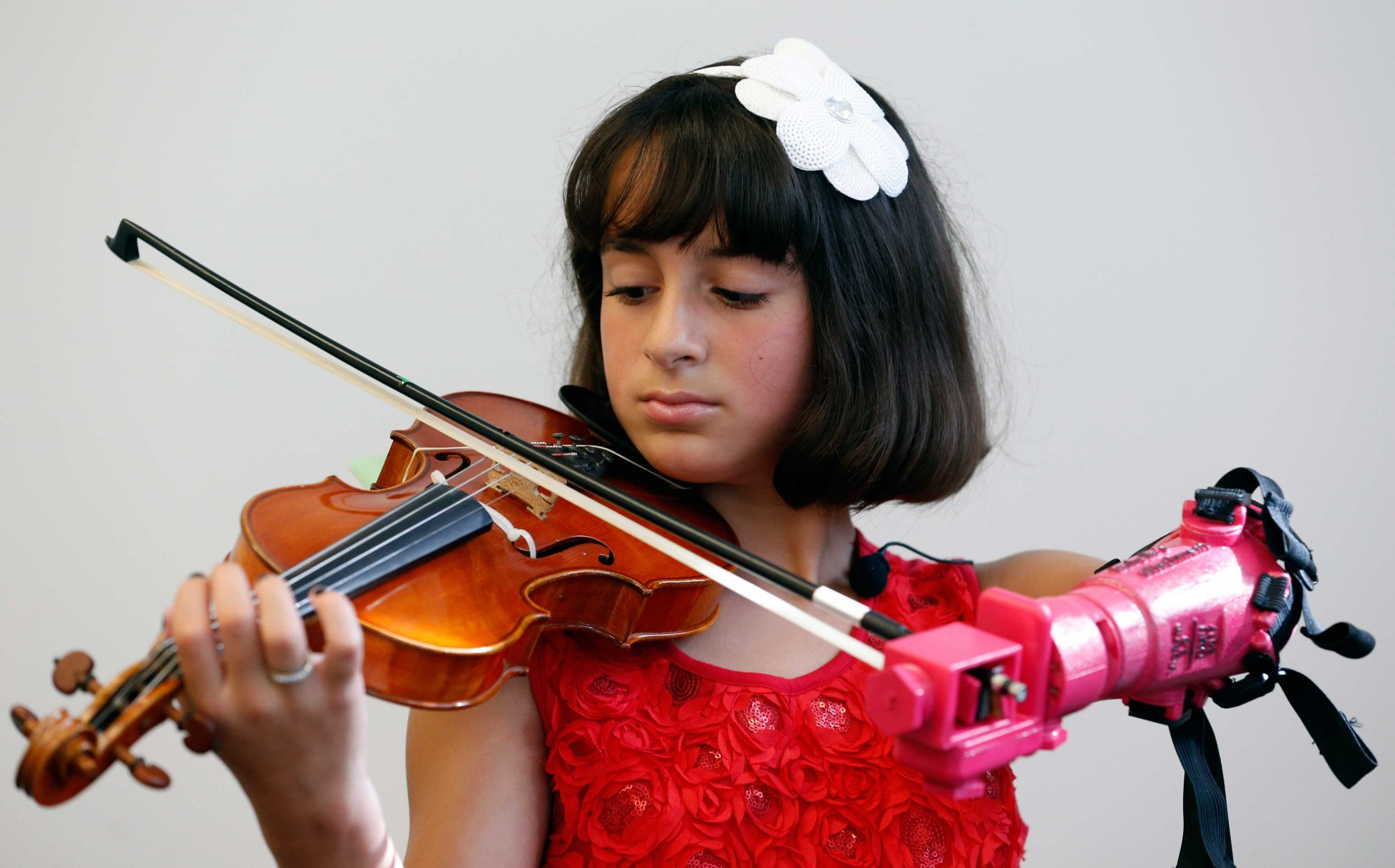 Girl, 10, Is Able to Play the Violin After a Group of Students Design a New (Hot Pink!) Prosthetic Arm