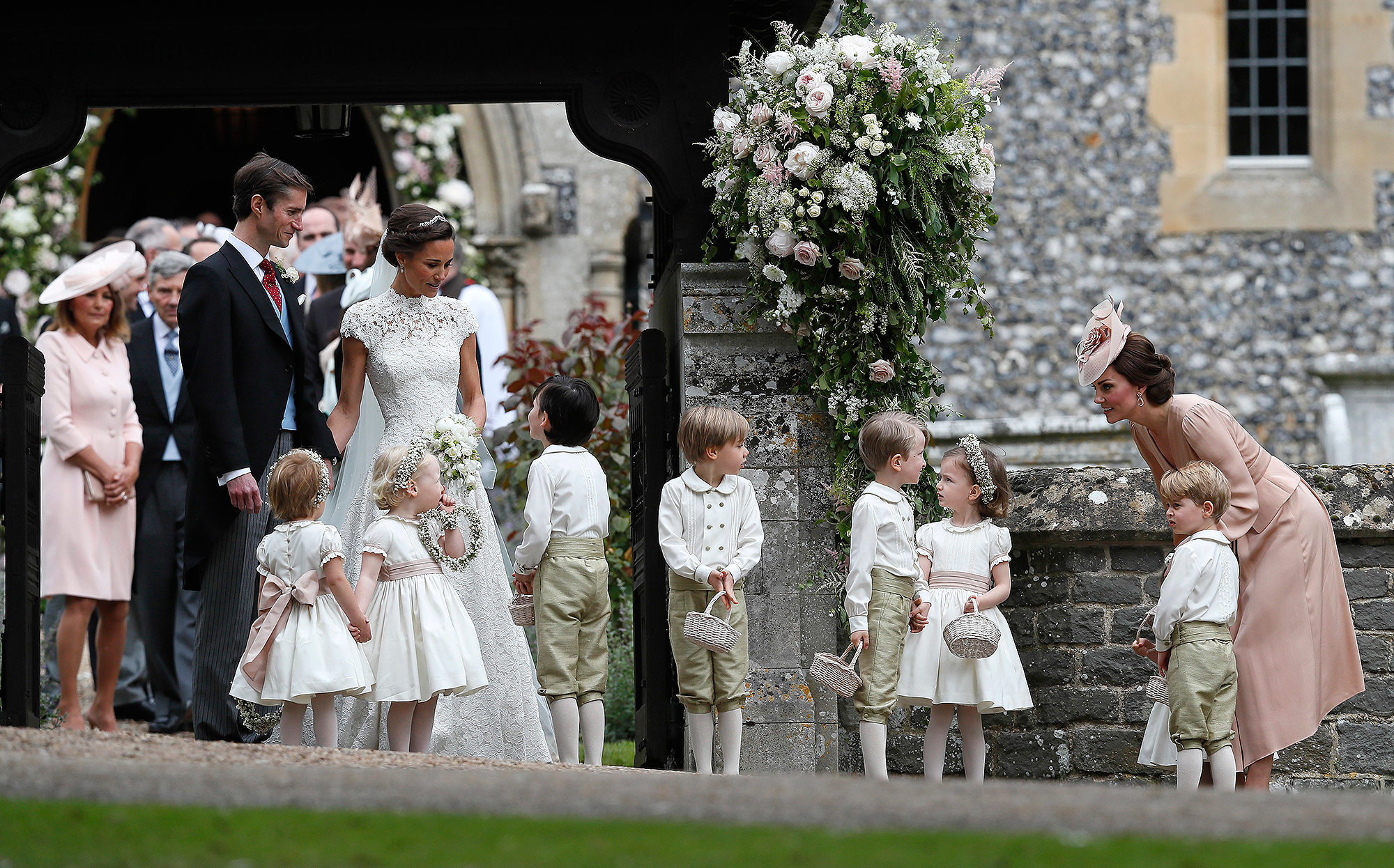 Prince George and Princess Charlotte stayed close to mom Kate after the ceremony