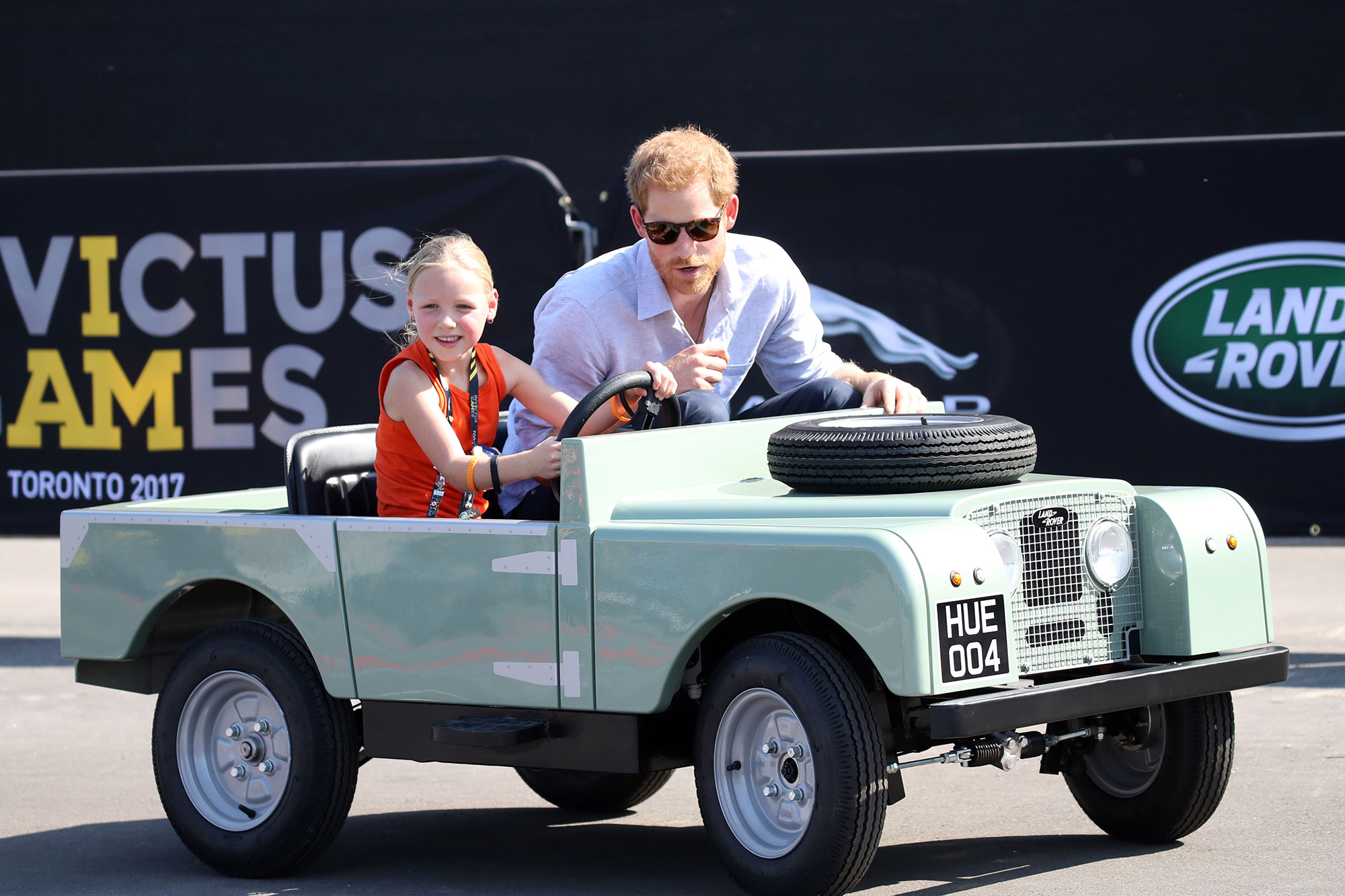 Cuteness Overload! Prince Harry Races Around with an Adorable 5-Year-Old Chauffeur — See All the Pics