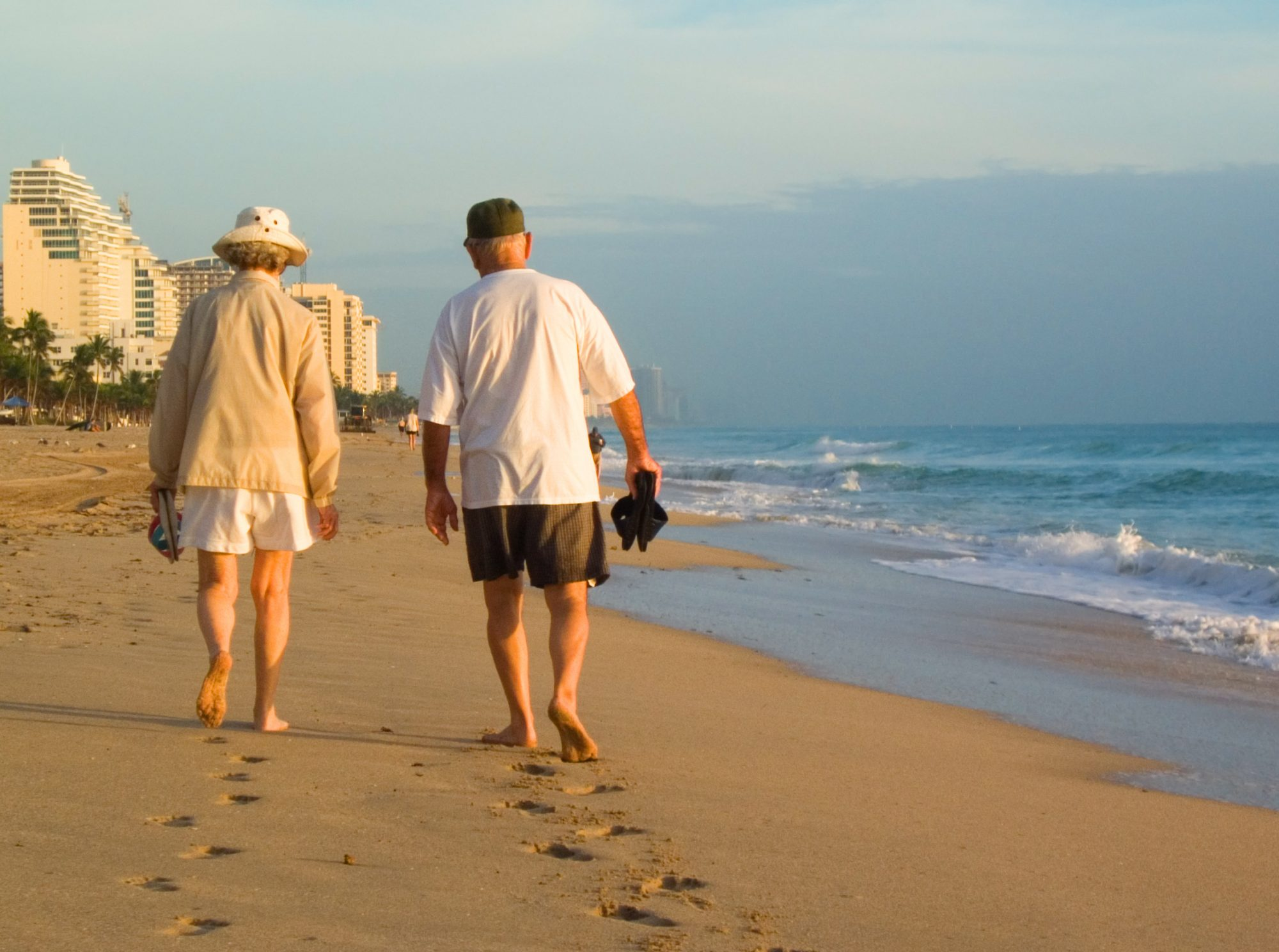 Senior Couple Walking on Beach in Fort Lauderdale