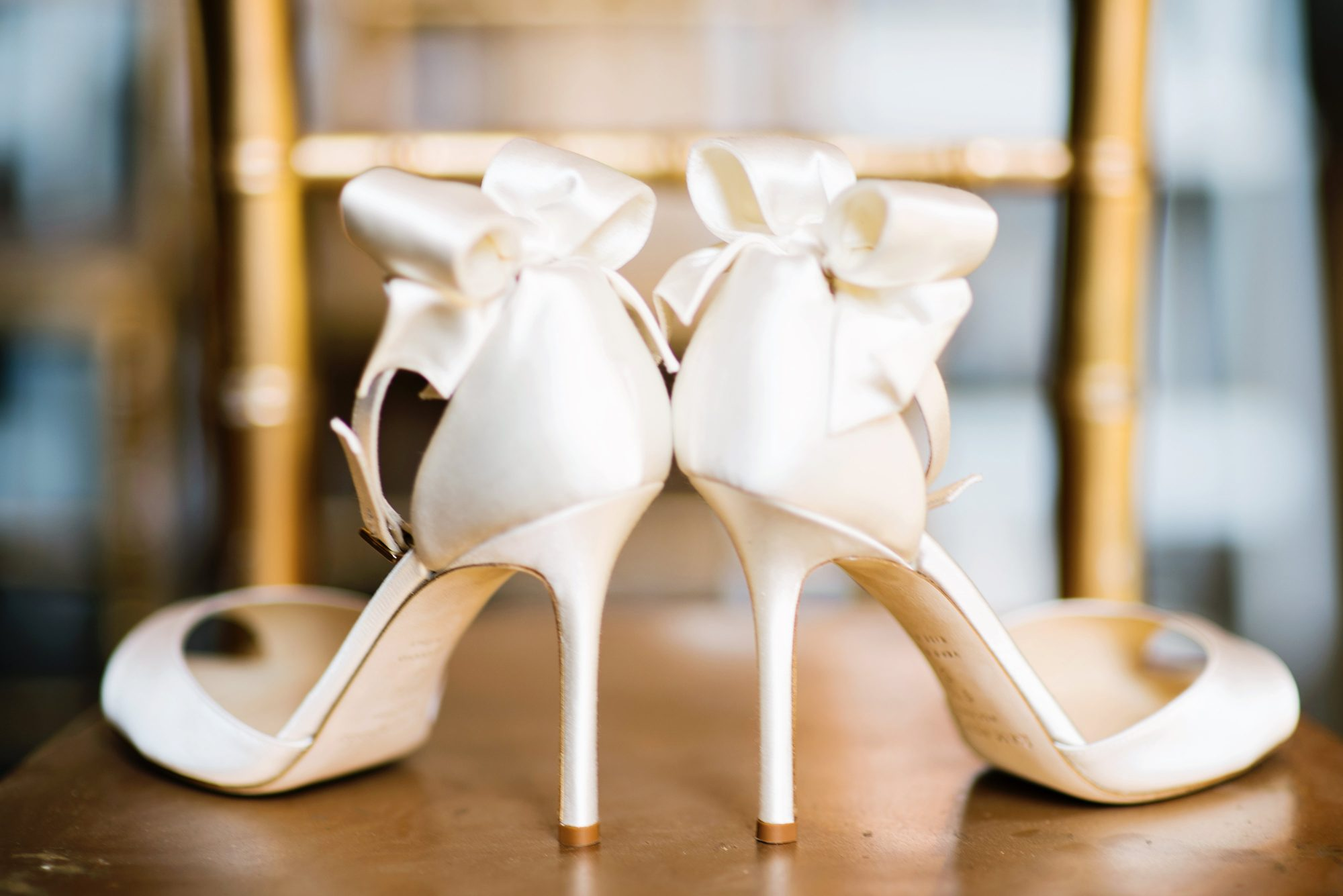 Ivory Wedding Shoes with Bow on Chair
