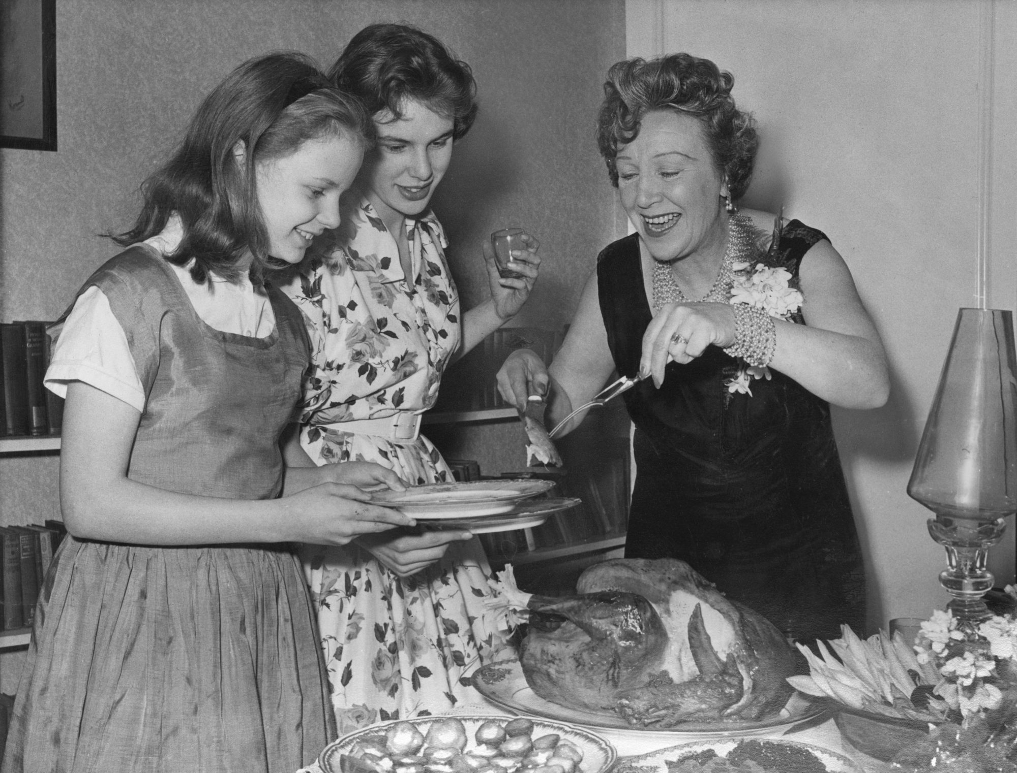 woman serving Thanksgiving turkey