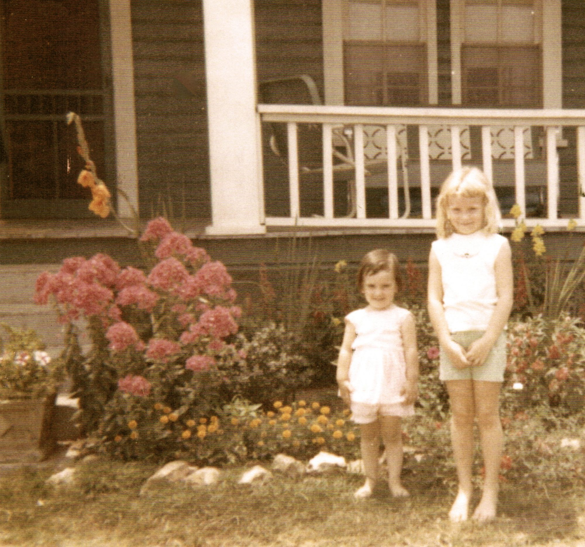 two girls in front of porch
