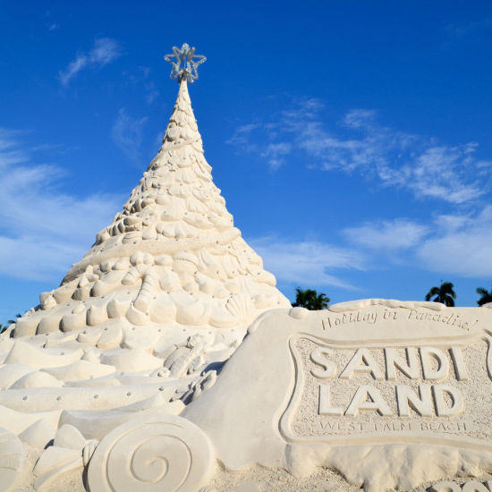 """Why do we love it? Because there is nothing more amazing than a Christmas tree built out of 600 tons of beach sand. Nothing. """"Sandi"""" is lit up at night and synched with music, adding a touch of Vegas and a boatload of whimsy."""