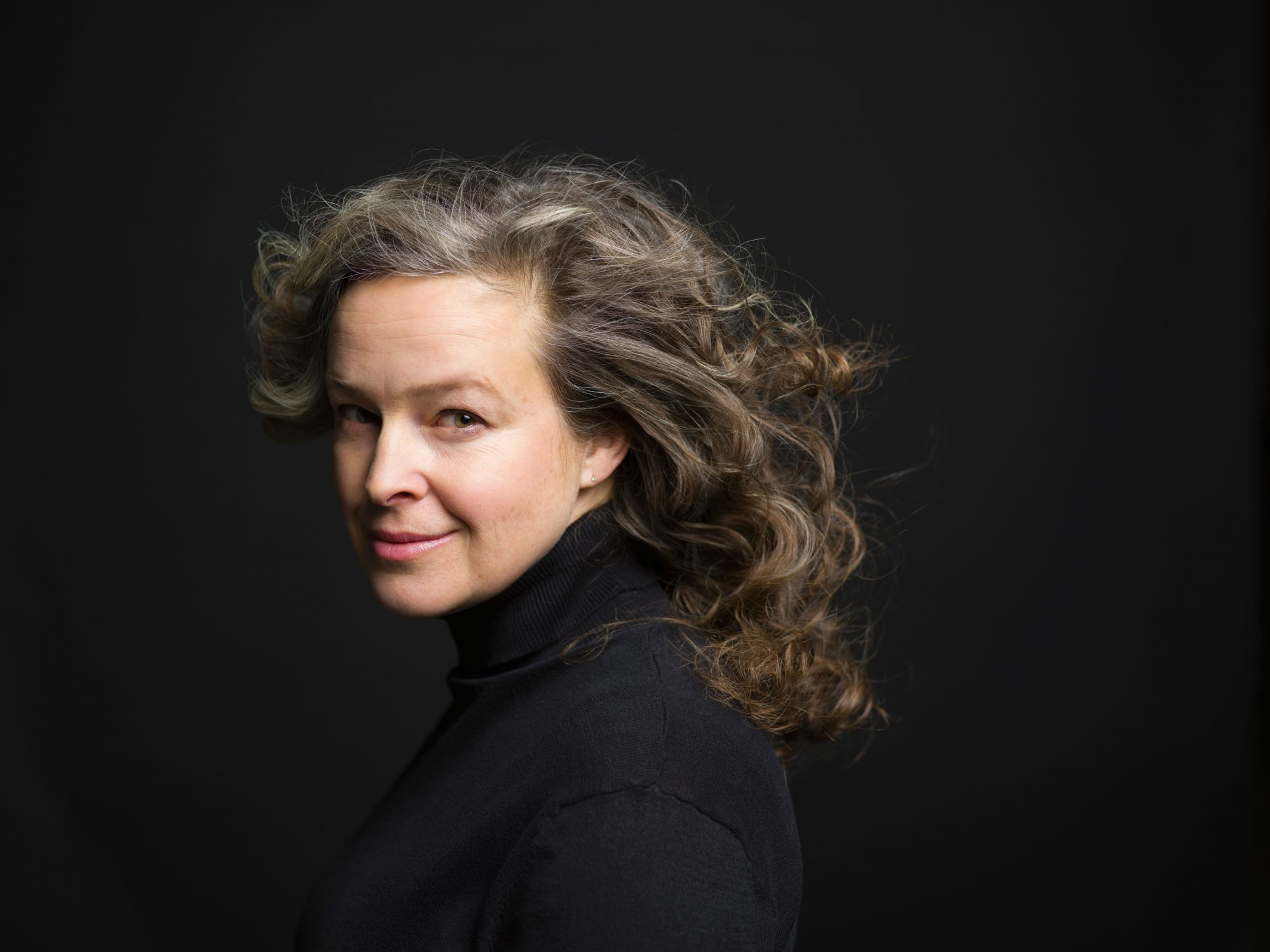 Woman with Gray Curly Hair