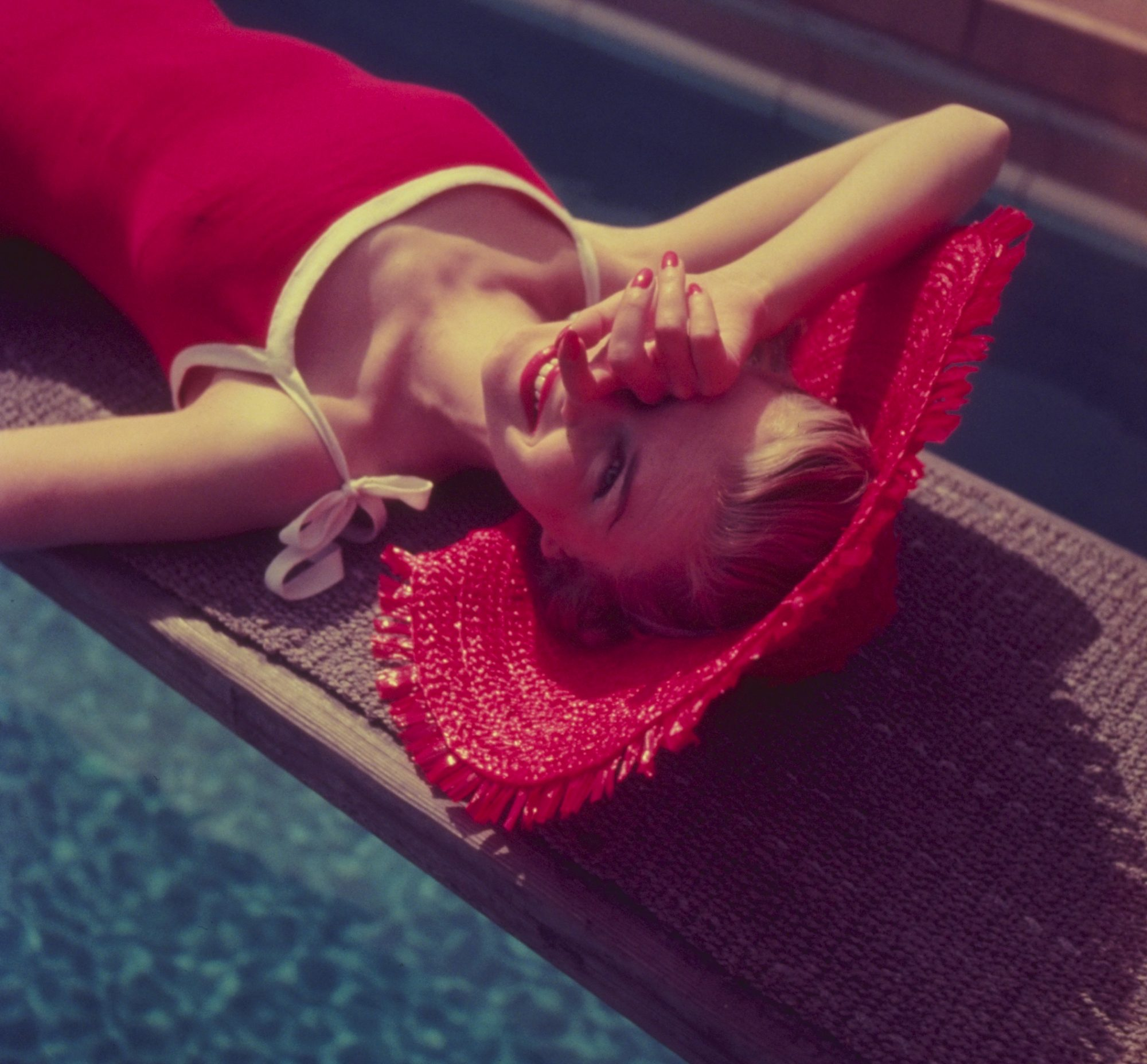 Woman in Red Laying by Pool