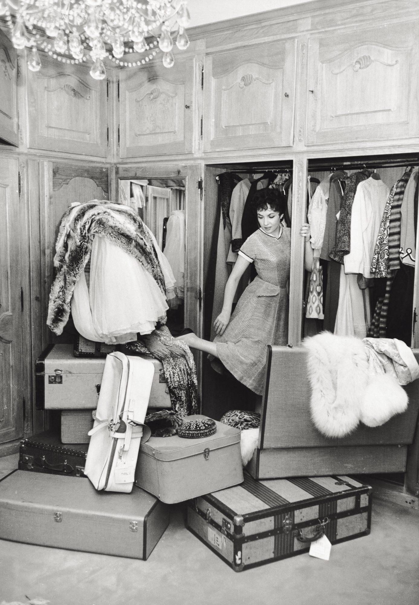 Woman in Wardrobe with Clothes