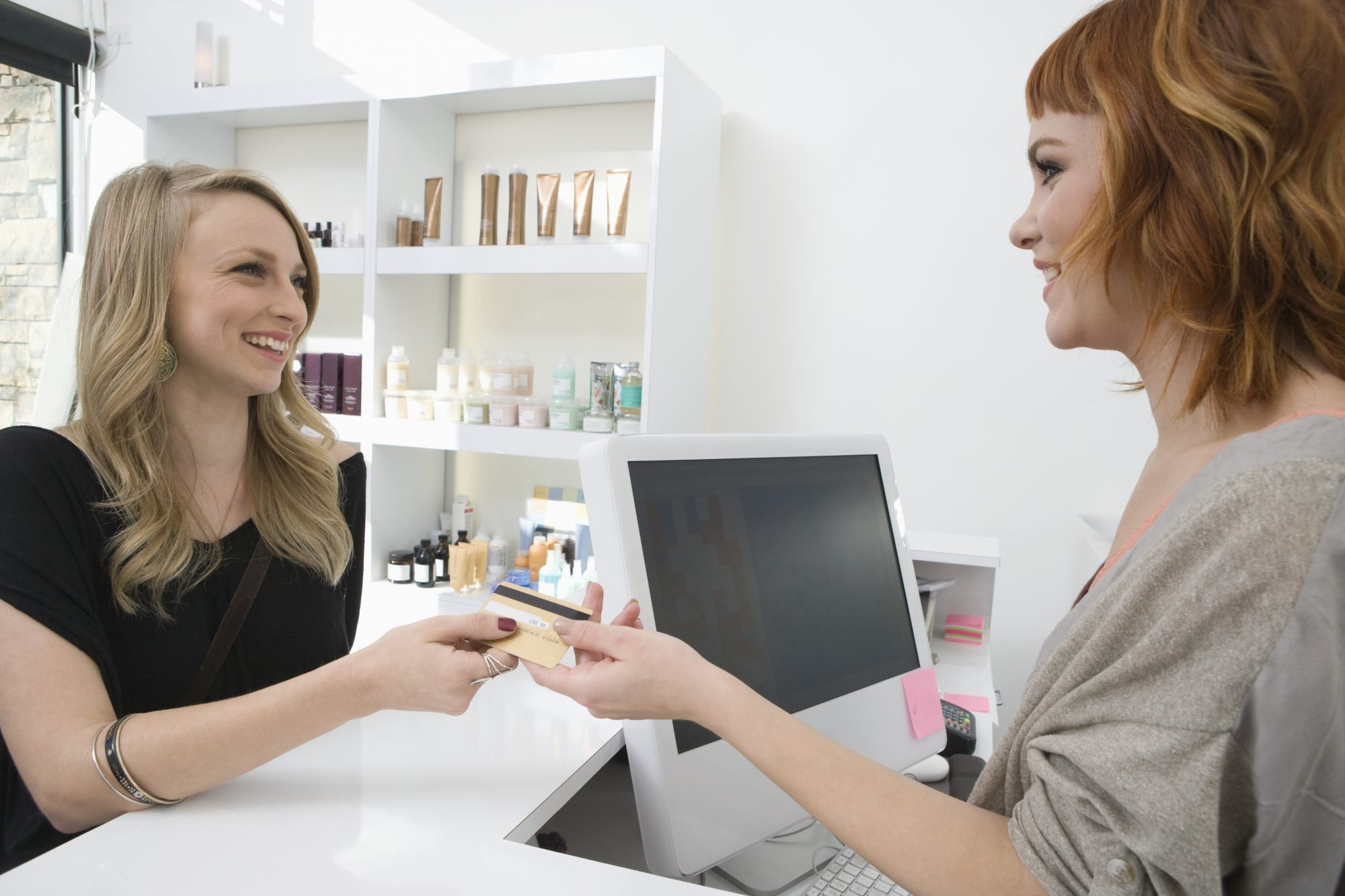 Woman Paying Hair Stylist
