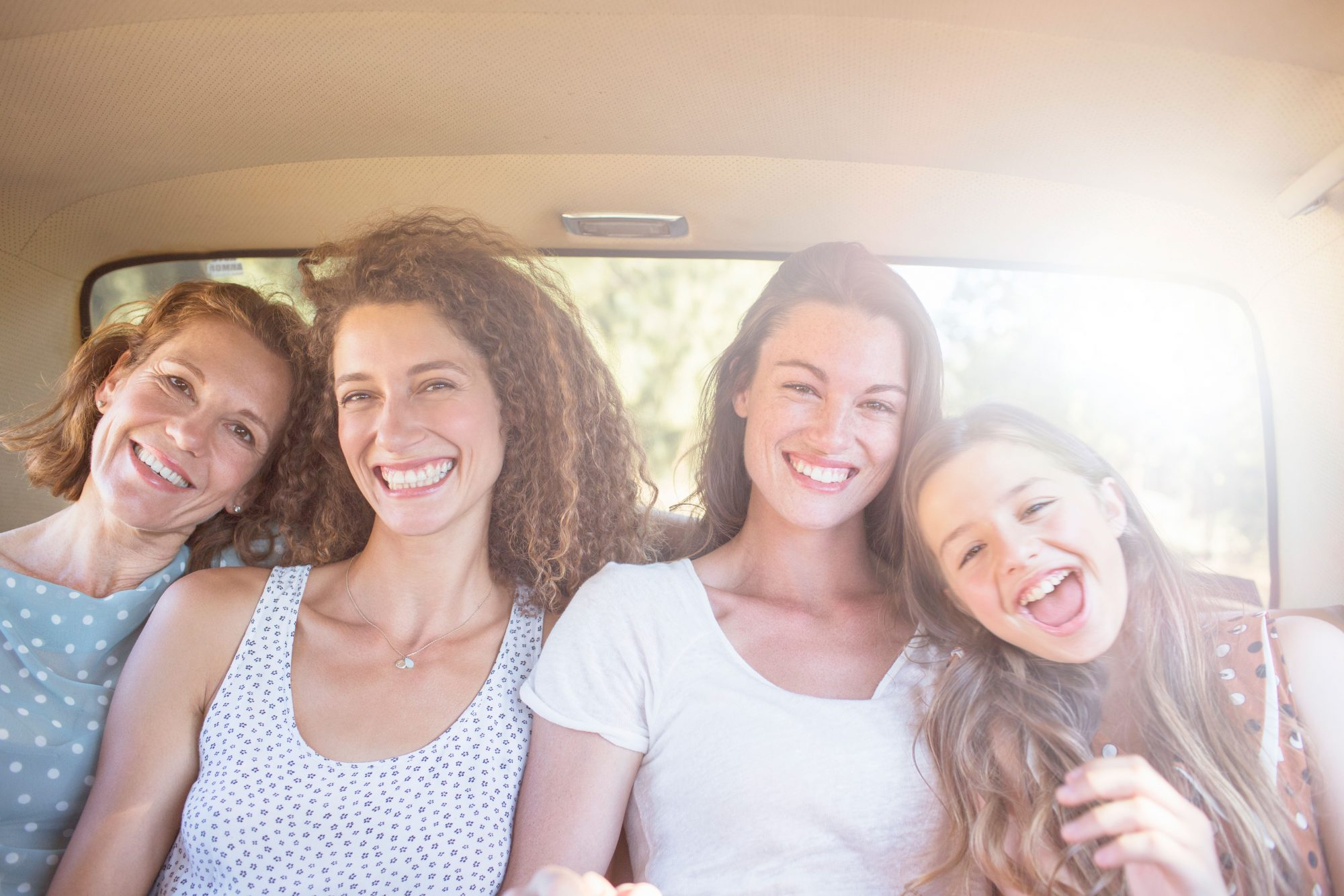 Women Sitting in Backseat of Car
