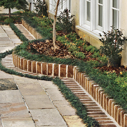 Design a brick border for a garden courtyard southern living for Southern living landscape design