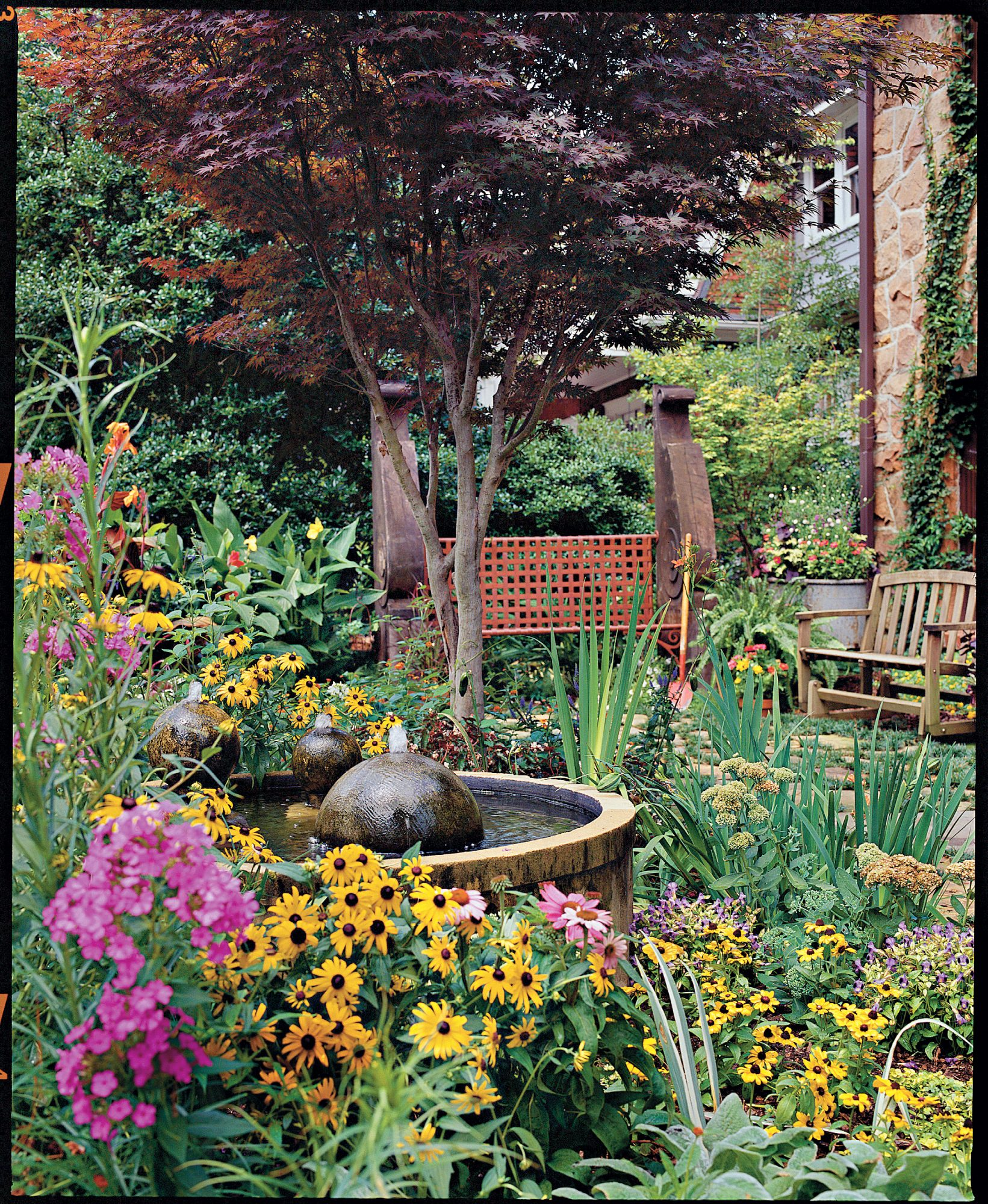 Colorful cottage courtyard southern living for English courtyard garden design