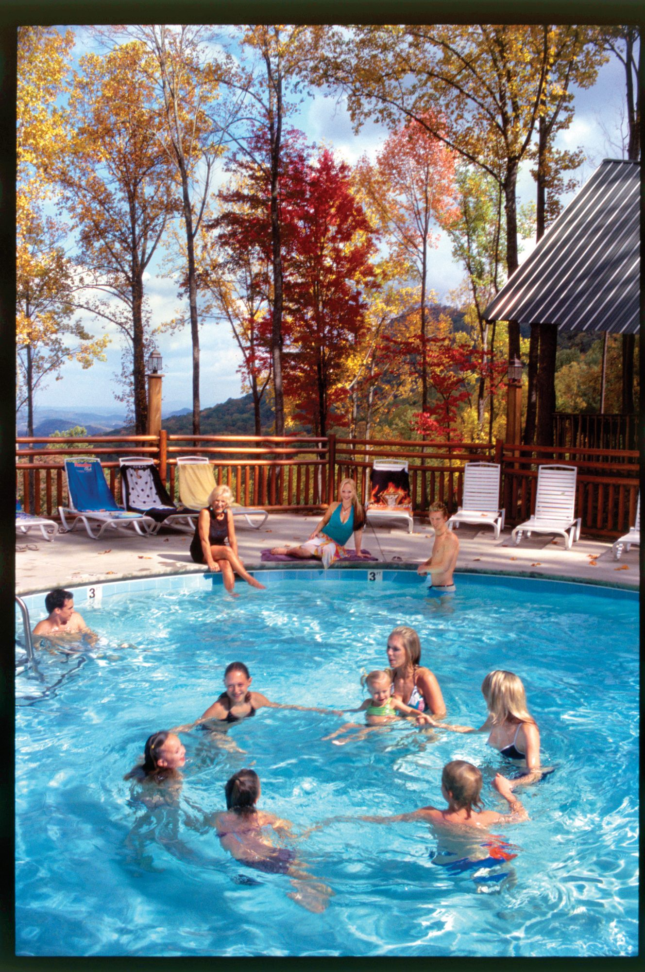 family in pool at smoky mountain cabin rental
