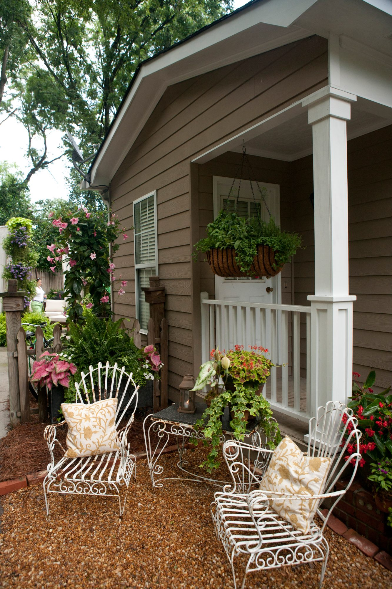 See how an uninviting back door was transformed with plants, seating, and window boxes.
