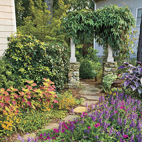 Sweeps Of Flowers Flank A New Stone Path That Connects My Side Yard With The Front Porch