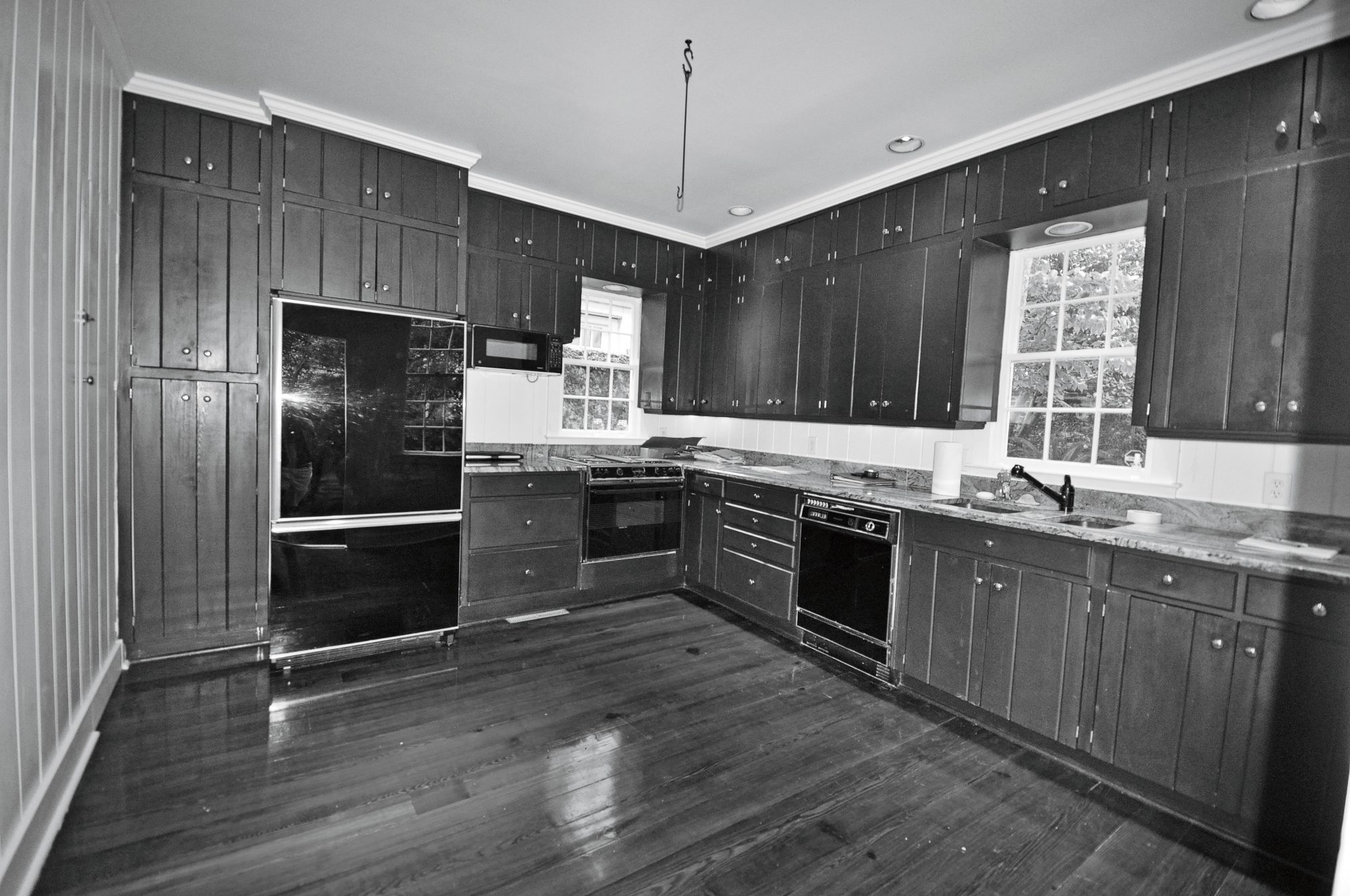 Dated Farmhouse Kitchen with Wood Cabinets