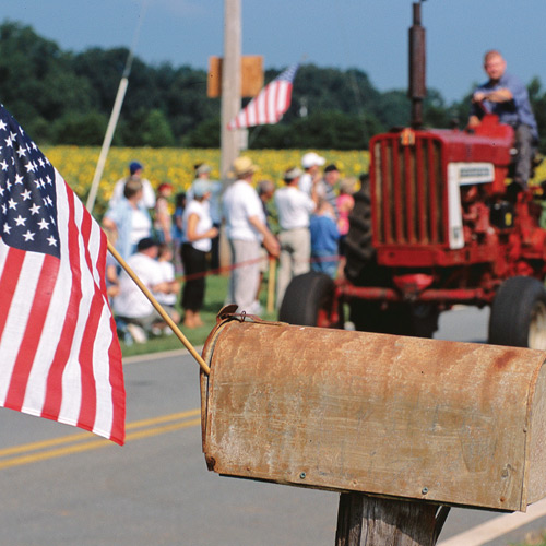 small town 4th of july parade with tractors