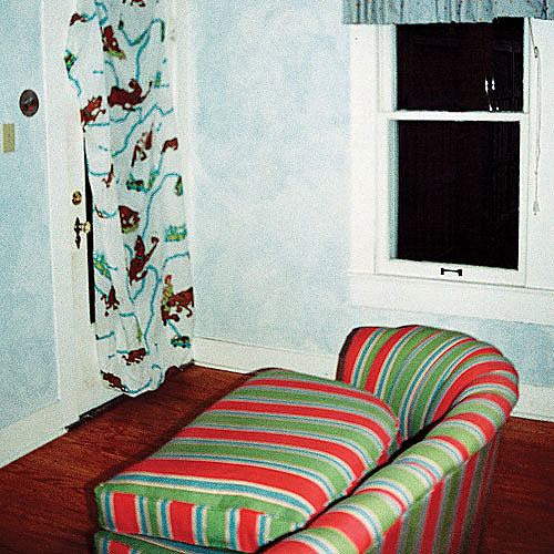 before photo of an outdated guestroom that's going to be renovated into a bathroom