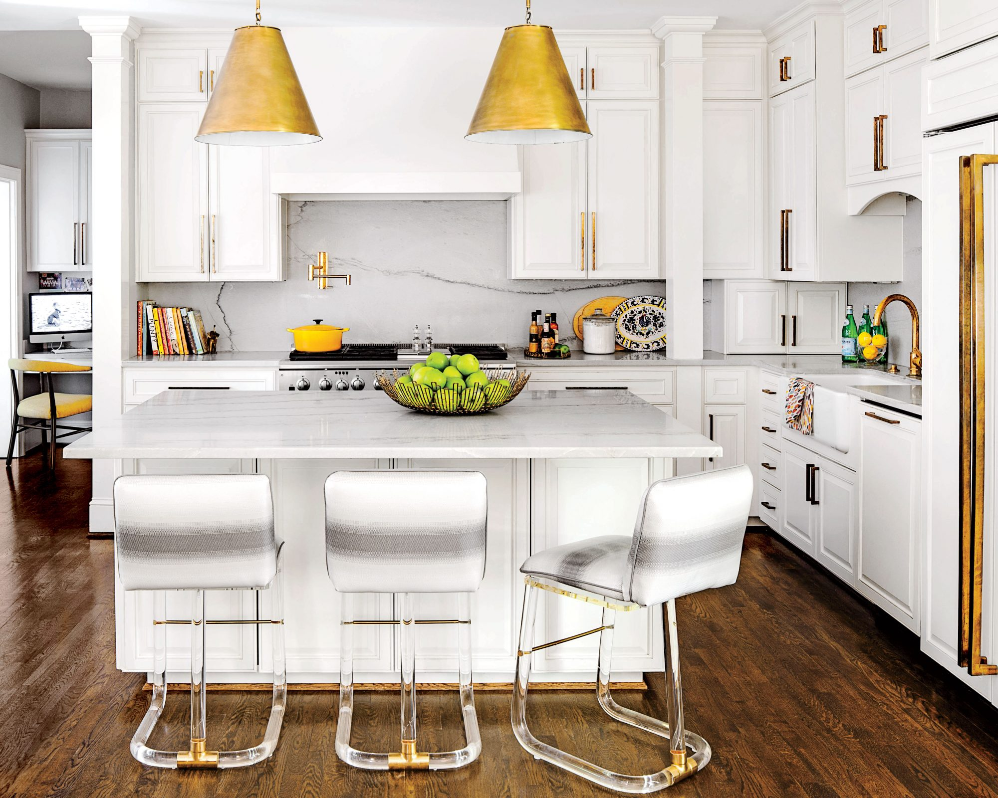 White Kitchen with Marble Countertops and Acrylic Stools