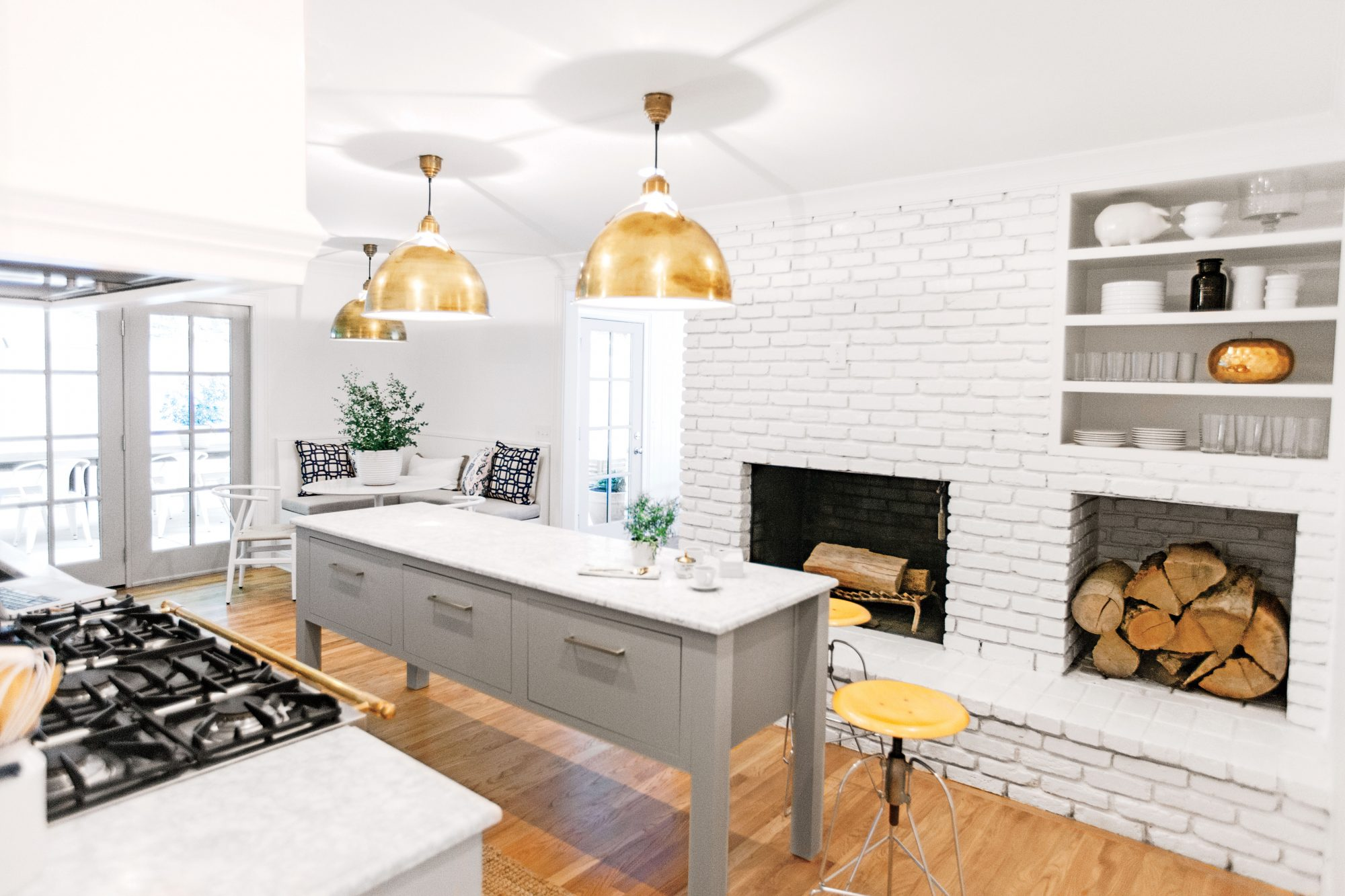 Kitchen with Brass Circa Lighting pendants and Schoolhouse Electric hardware
