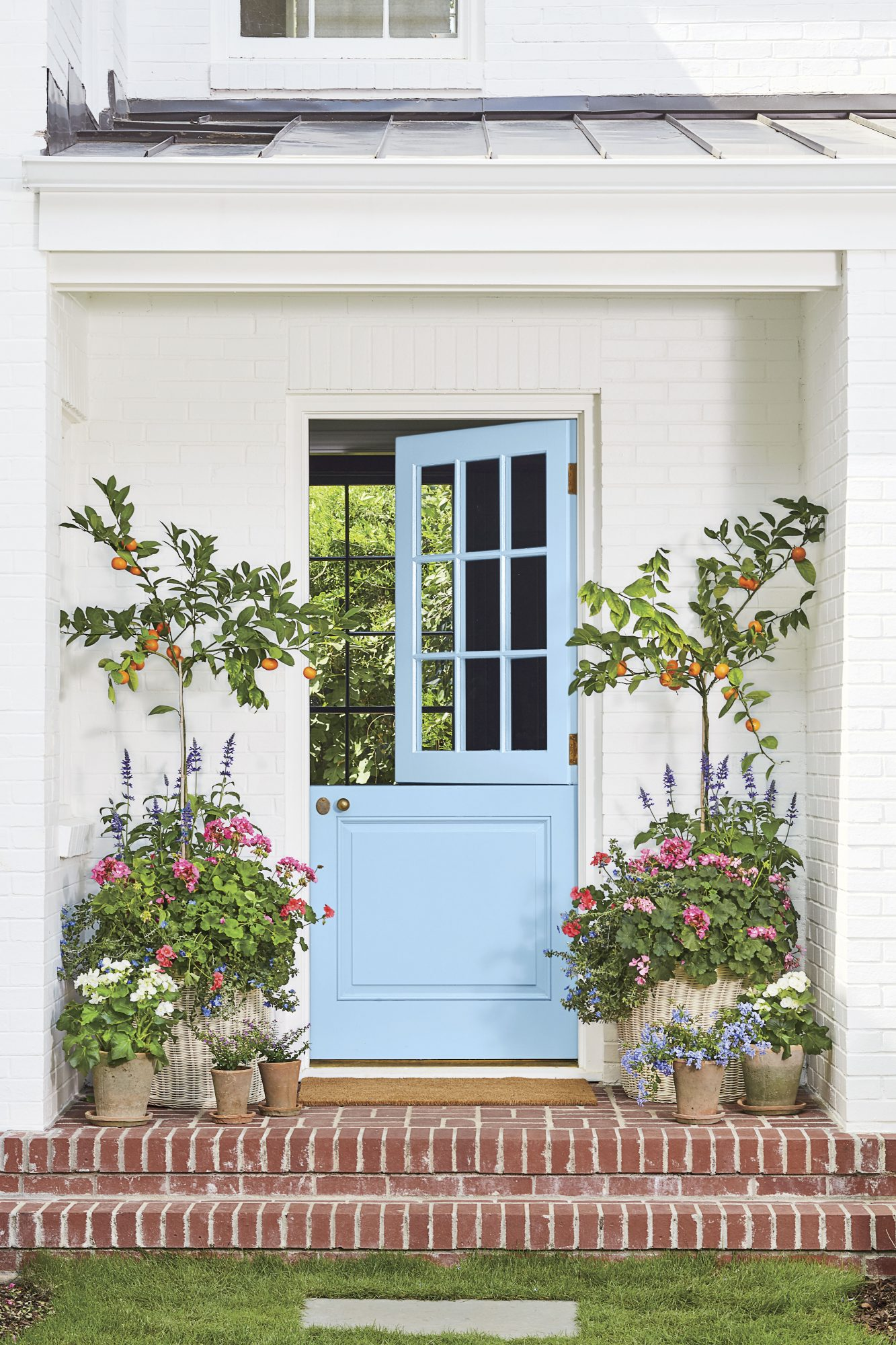 Blue Skies Front Door with Orange Trees and Flowers