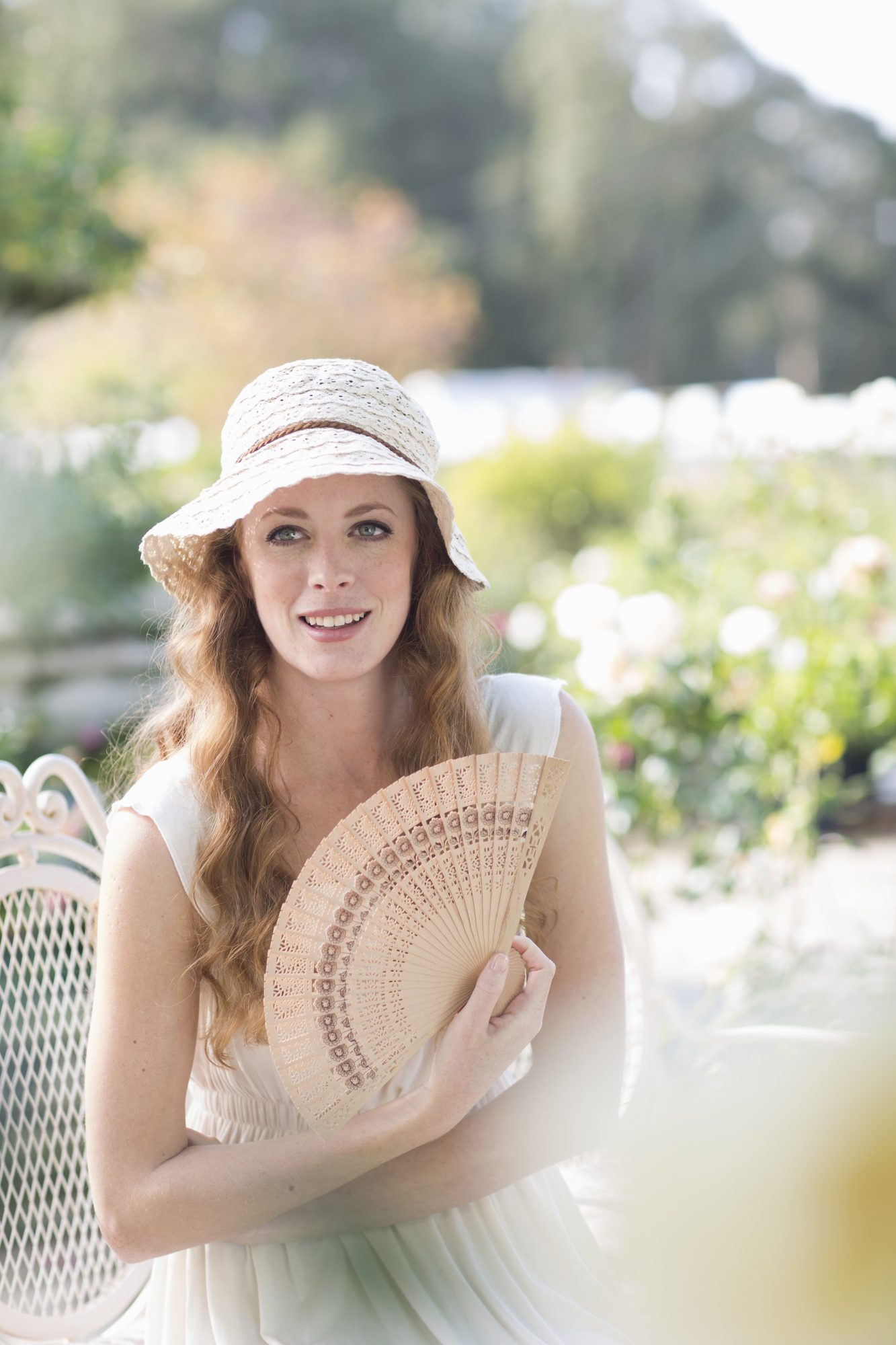 Young woman with hand fan