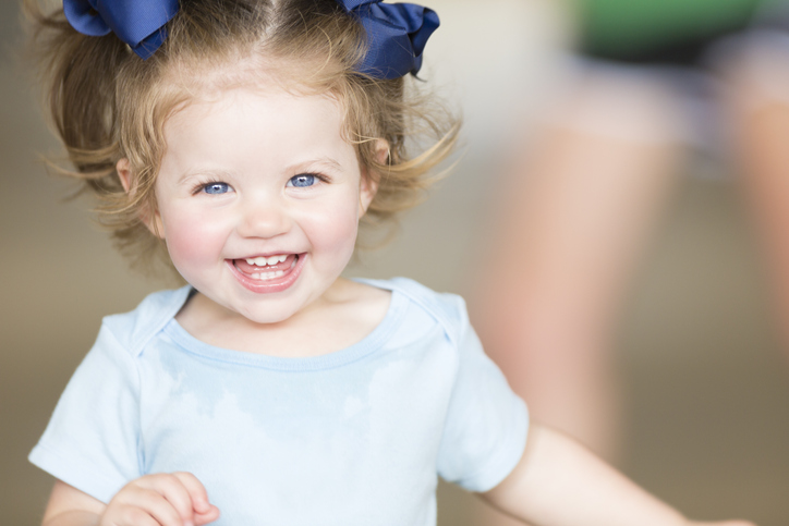 Cute toddler girl laughing and smiling