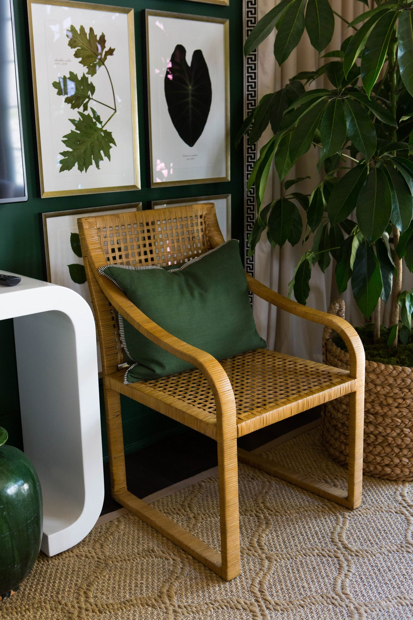 Woven Chair with Green Pilow