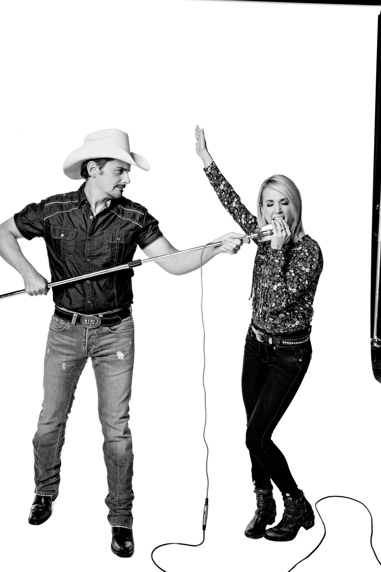 Brad and Carrie Sharing a Microphone