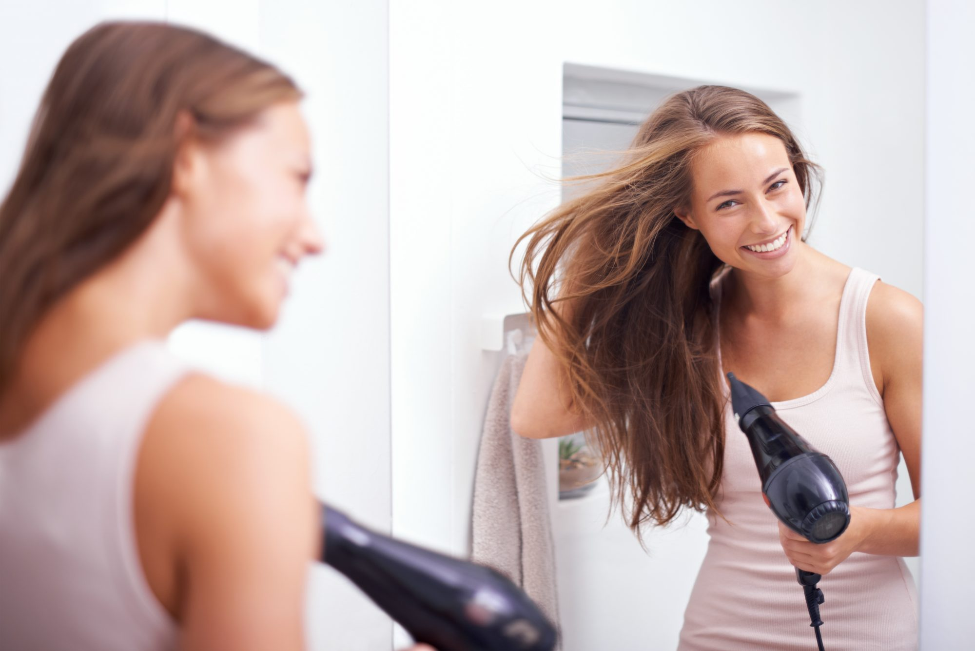 Woman blowdrying her hair