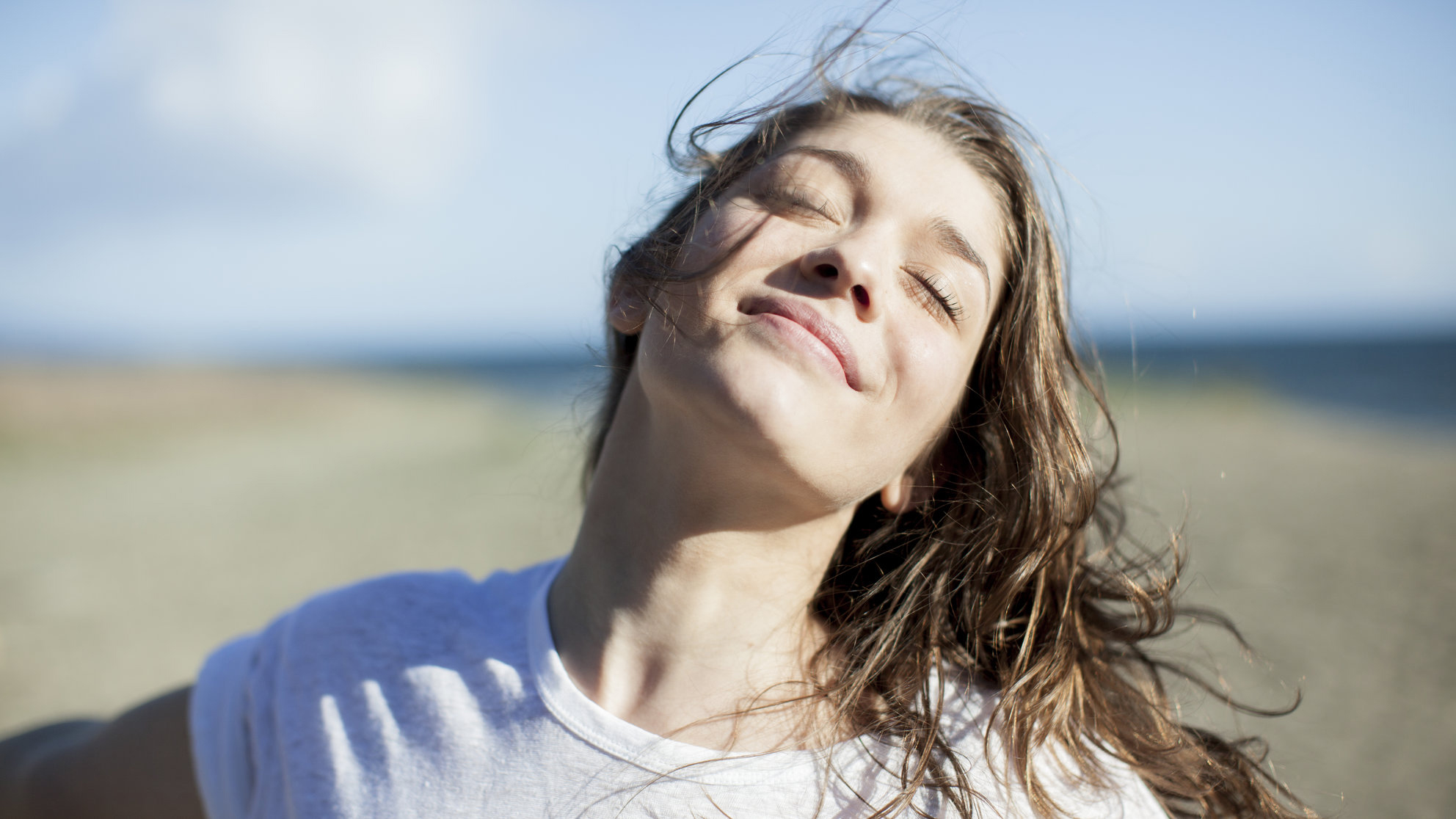 Young Girl Smiling in the Sun