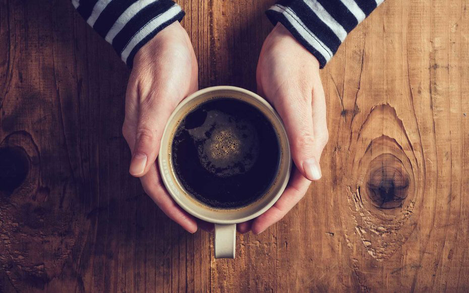 Holding a Coffee Cup