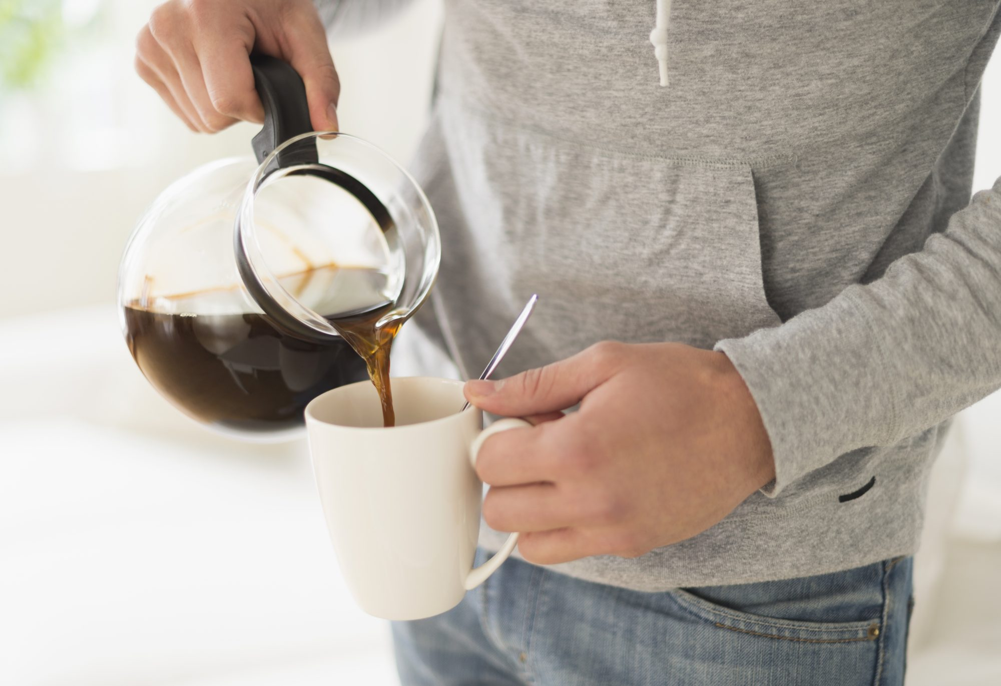 Man pouring coffee from coffeepot
