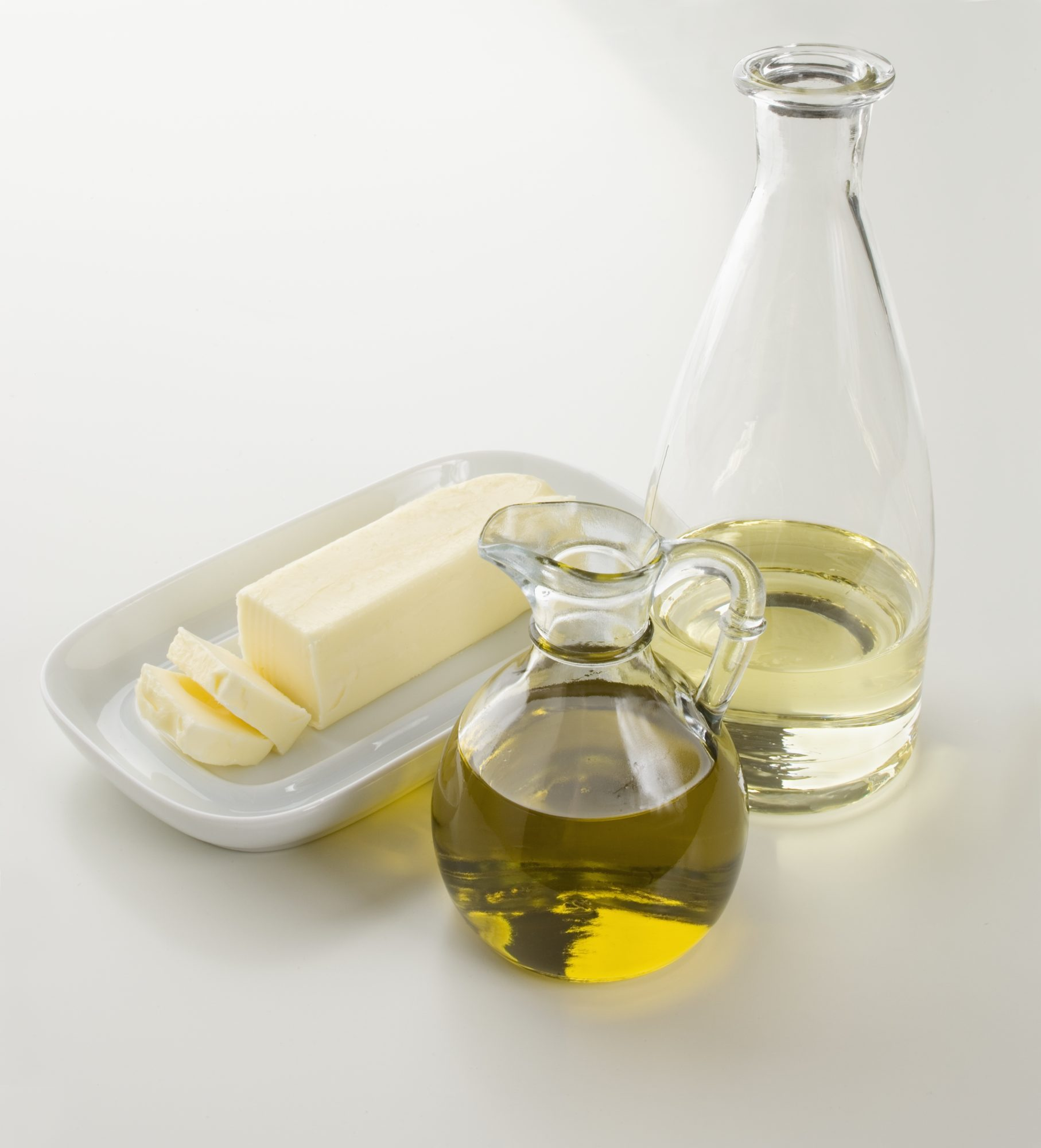 Oil, Butter, and Water on Table