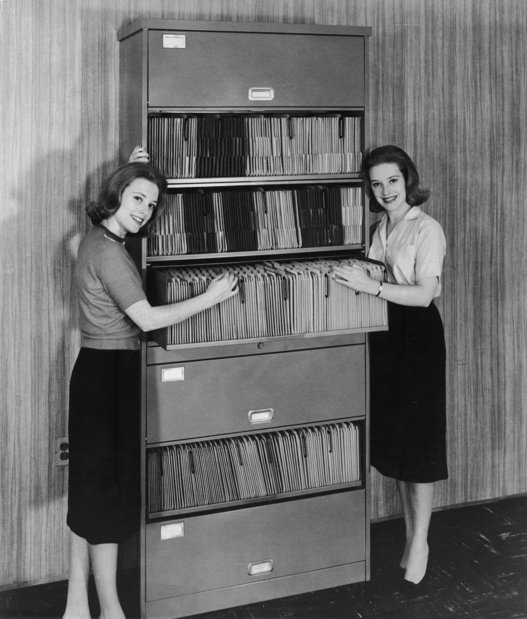 Vintage 1960s Women with Filing Cabinet in Office