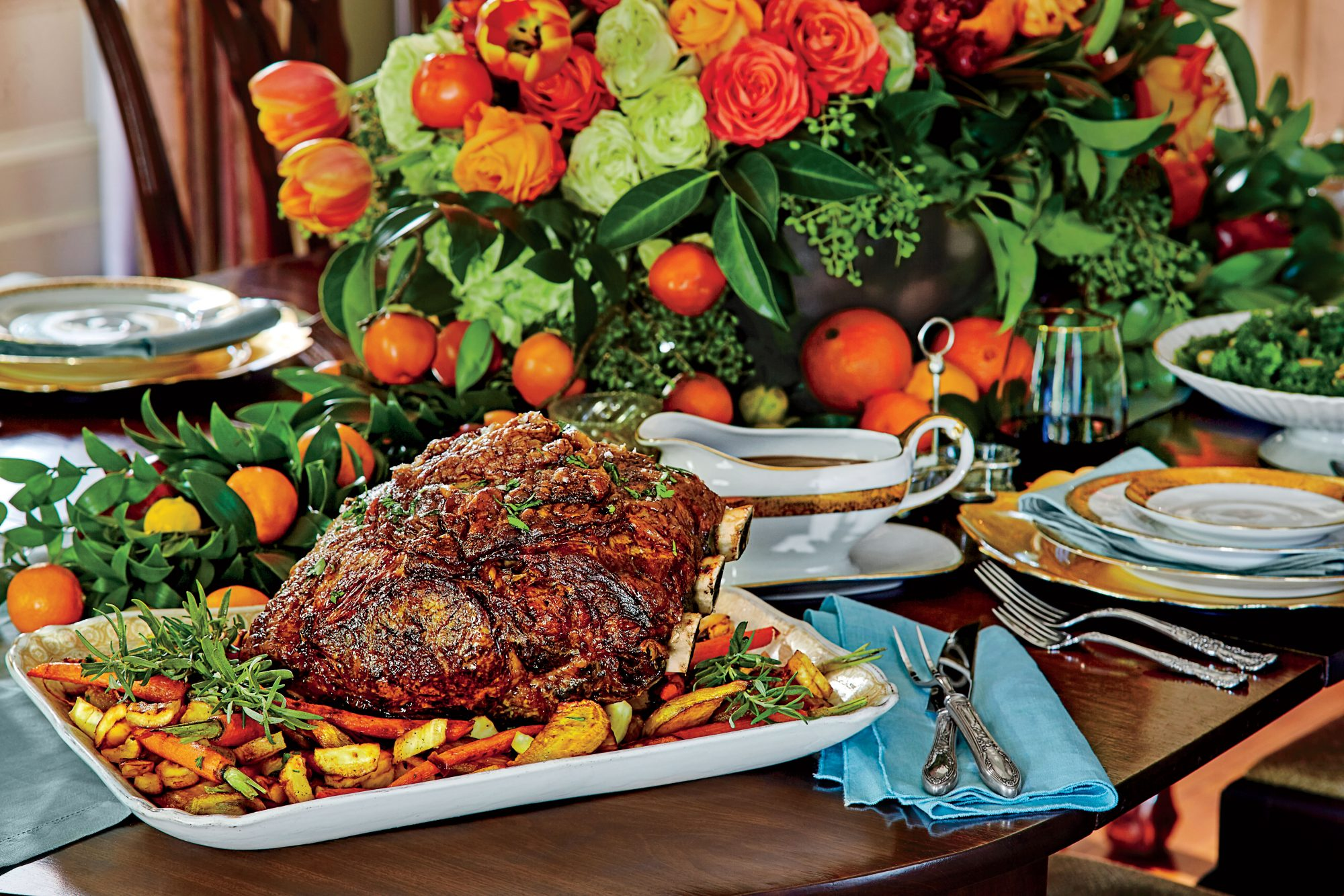 48 recipes you need to try this holiday season southern living peppercorn crusted standing rib roast with roasted vegetables forumfinder Images