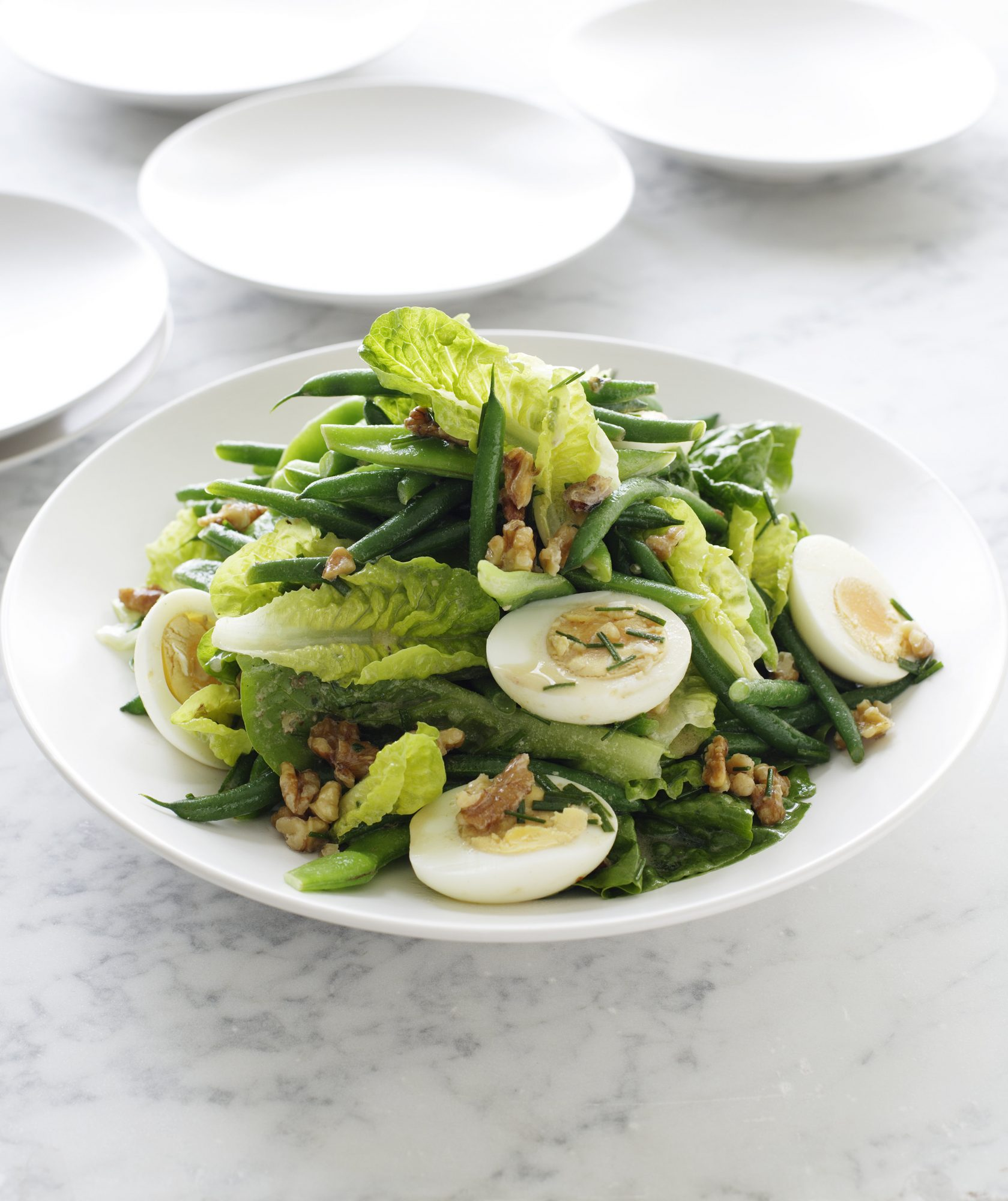 Egg in Salad on White Dish