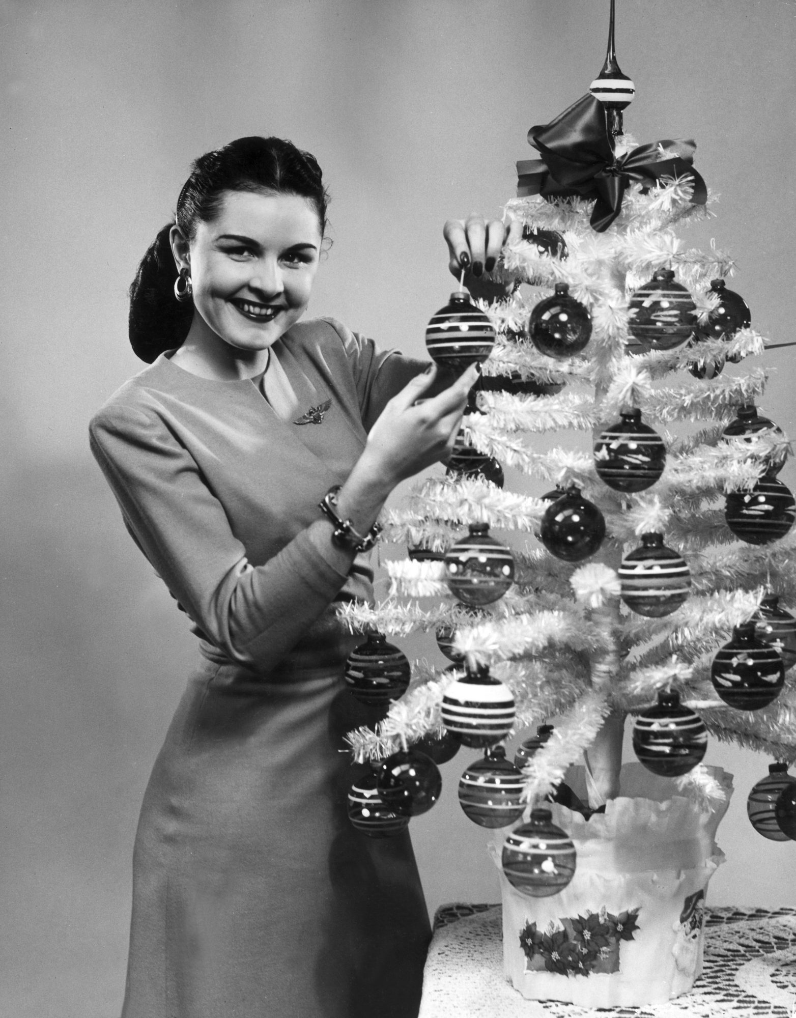 Vintage Woman Decorating Christmas Tree
